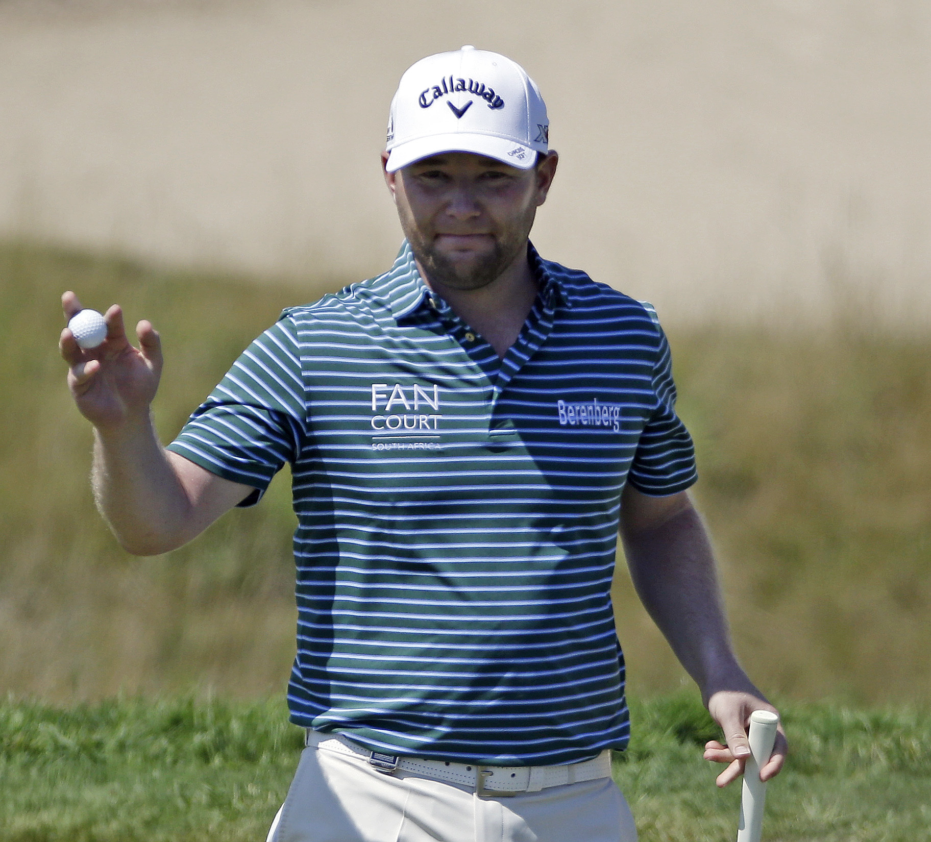 Branden Grace, of South Africa, reacts after making a birdie on the first hole during the third round of the PGA Championship golf tournament Saturday, Aug. 15, 2015, at Whistling Straits in Haven, Wis. (AP Photo/Brynn Anderson)