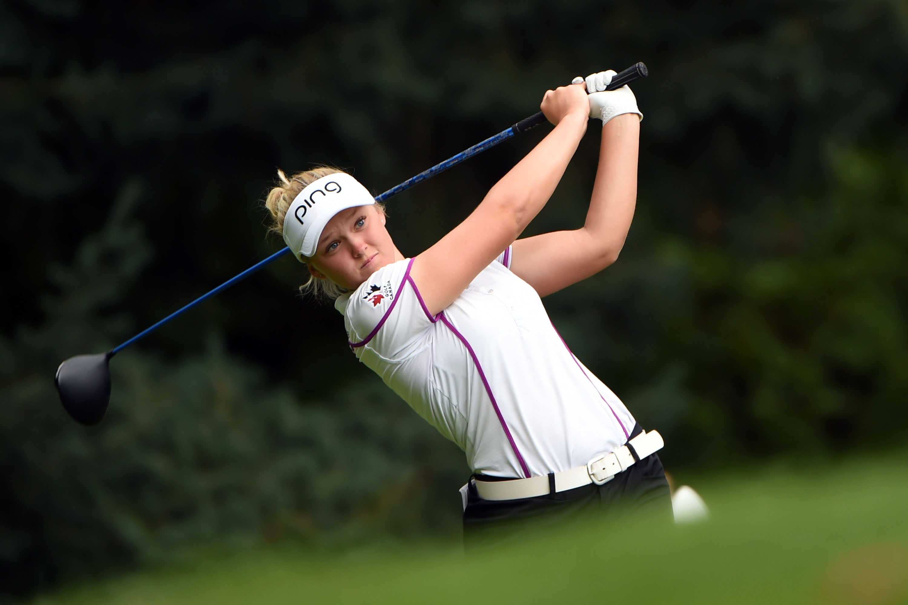 Brooke M. Henderson of Canada hits her tee shot on the third hole during the third round of the LPGA Cambia Portland golf tournament in Portland, Ore., Saturday, Aug. 15, 2015. (AP Photo/Steve Dykes)
