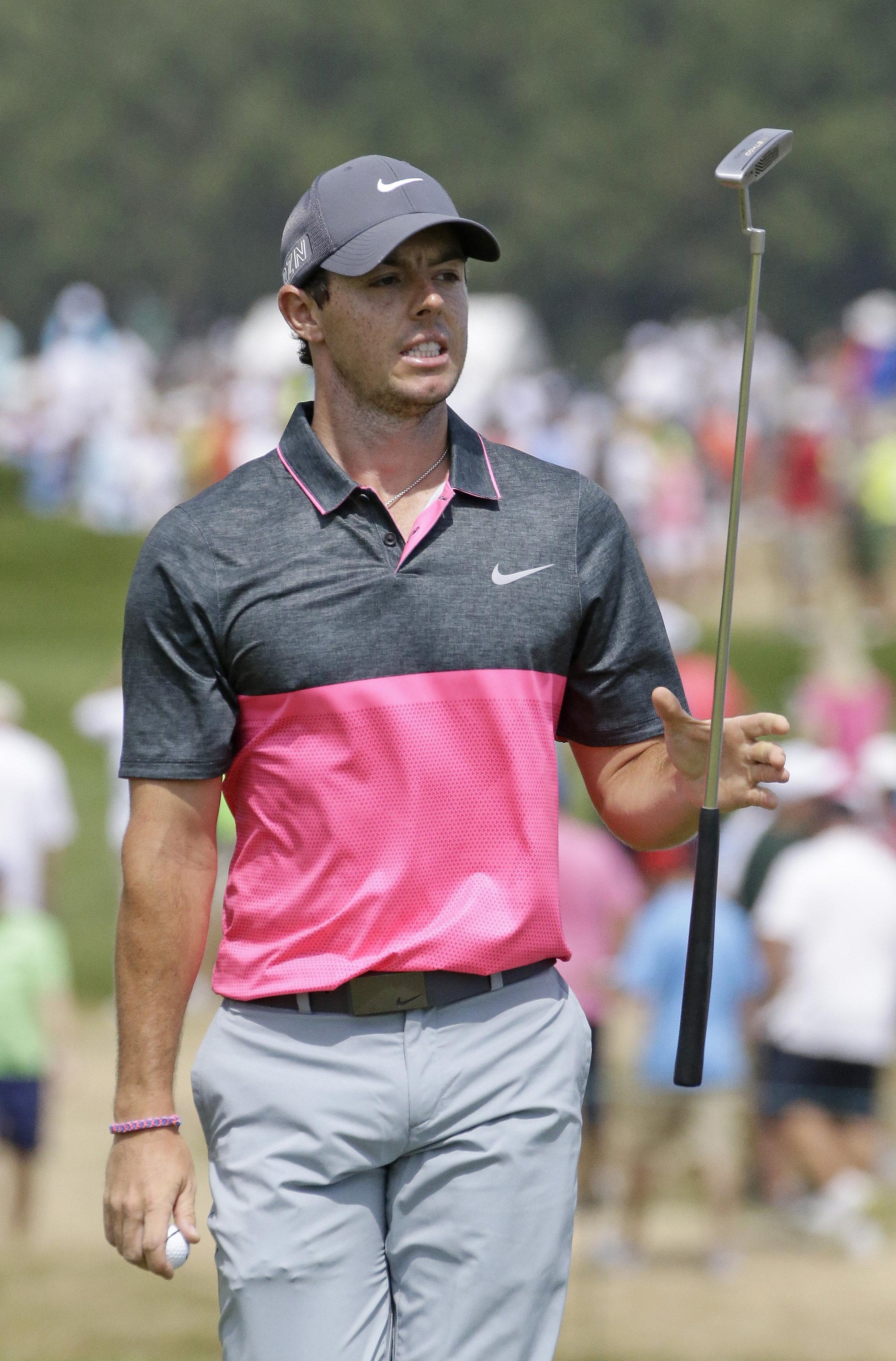 Rory McIlroy, of Northern Ireland, swings his putter on the second hole during the fourth round of the PGA Championship golf tournament Sunday, Aug. 16, 2015, at Whistling Straits in Haven, Wis. (AP Photo/Brynn Anderson)