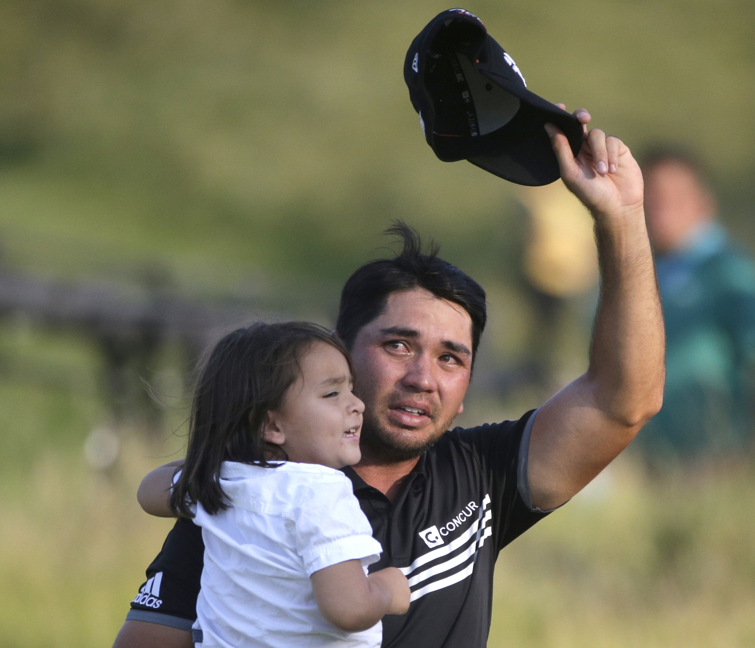 Jason Day, of Australia, holds his son Dash as he walks off the 18th green after winning the PGA Championship golf tournament Sunday, Aug. 16, 2015, at Whistling Straits in Haven, Wis.  (AP Photo/Jae Hong)