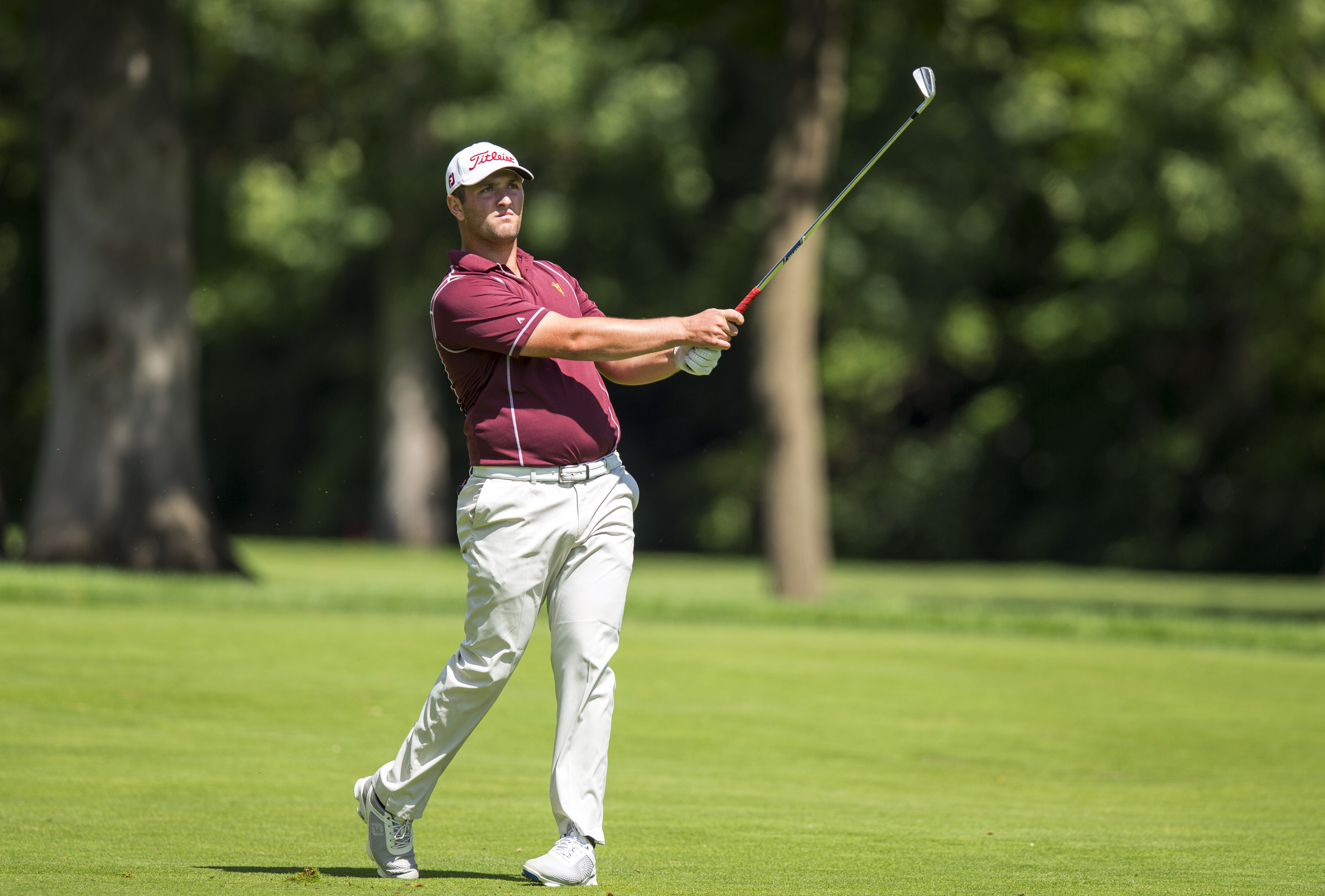In a photo provided by the USGA, Jon Rahm watches his second shot on the third hole during a match-play found in the U.S. Amateur golf tournament at Olympia Fields Country Club in Olympia Fields, Ill. on Thursday, Aug. 20, 2015. (John Mummert/USGA via AP)