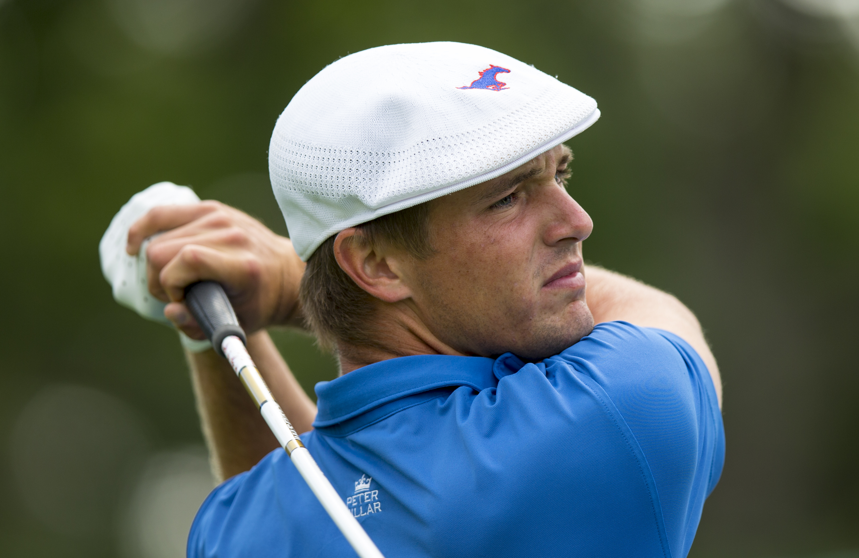 In a photo provided by the USGA< Bryson DeChambeau plays his tee shot on the 11th hole during a match-play round at the U.S. Amateur golf tournament at Olympia Fields Country Club in Olympia Fields, Ill., on Thursday, Aug. 20, 2015. (Chris Keane/USGA via