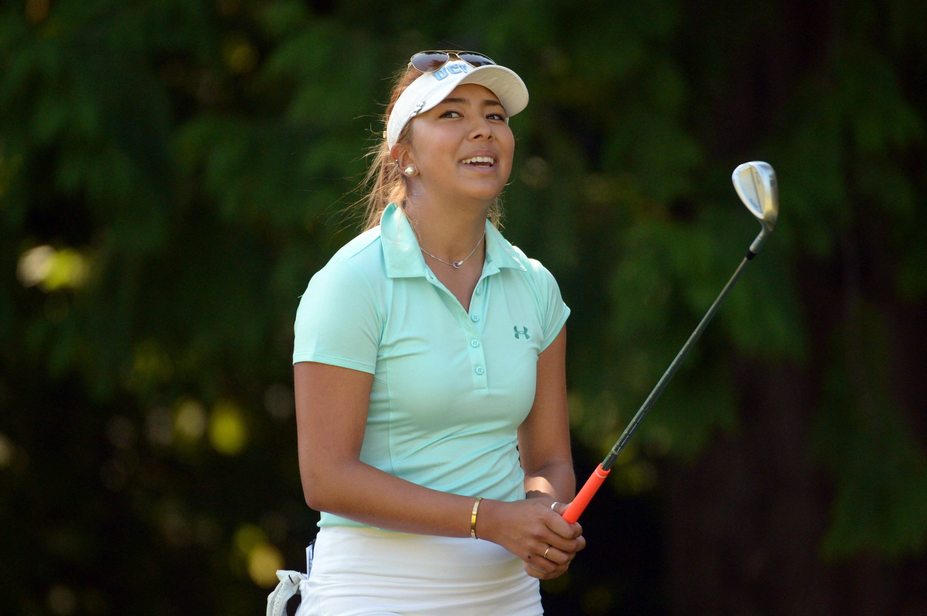 Alison Lee, of the United States, reacts after her shot onto the seventh green at the Canadian Pacific Women's Open golf tournament at the Vancouver Golf Club in Coquitlam, British Columbia, Saturday, Aug. 22, 2015. (Jonathan Hayward/The Canadian Press vi
