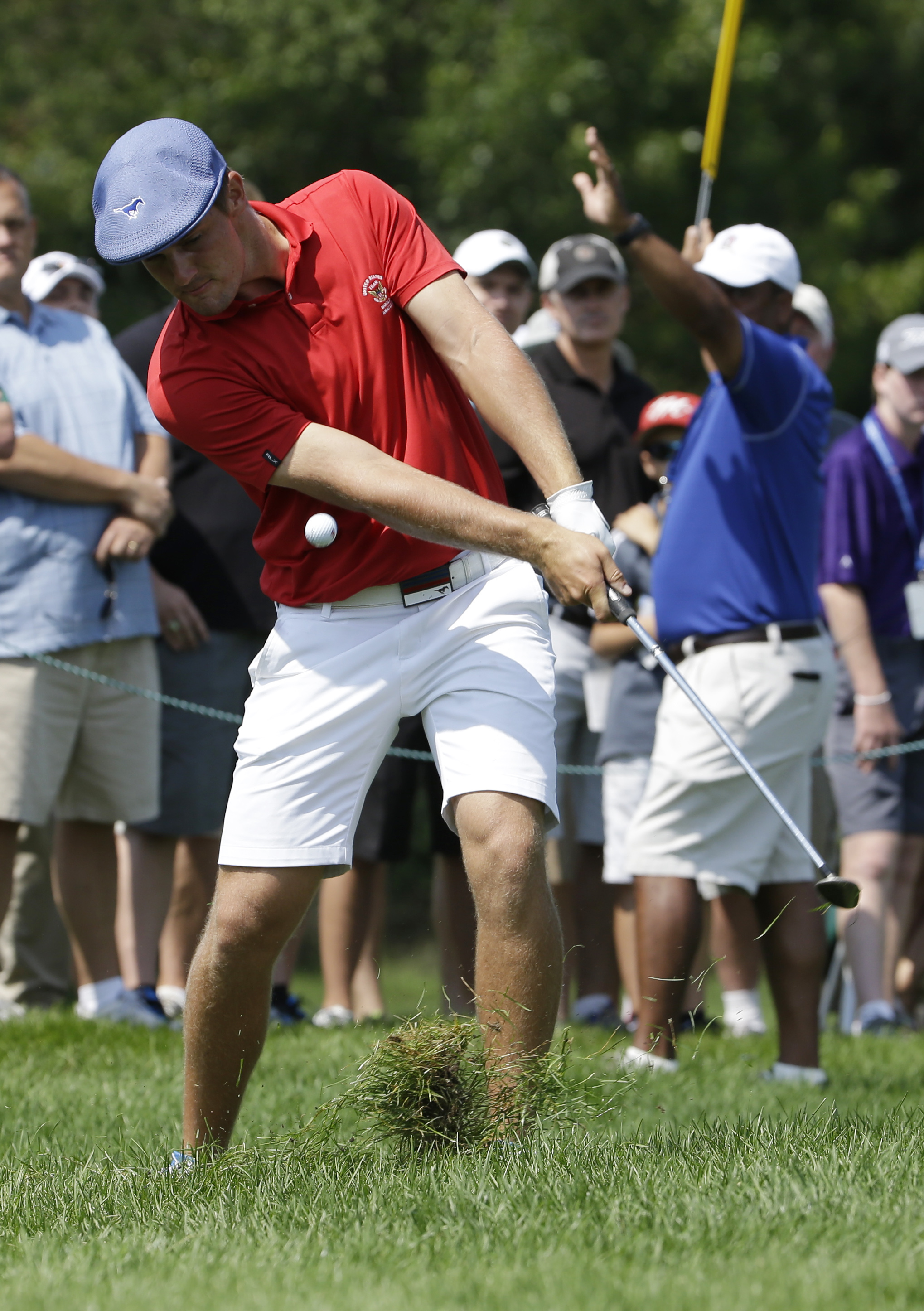 Bryson DeChambeau hits to the 18th green during the final round of the U.S. Amateur golf tournament at Olympia Filelds Country Club on Sunday, Aug. 23, 2015, in Olympia Fields, Ill. (AP Photo/Nam Y. Huh)