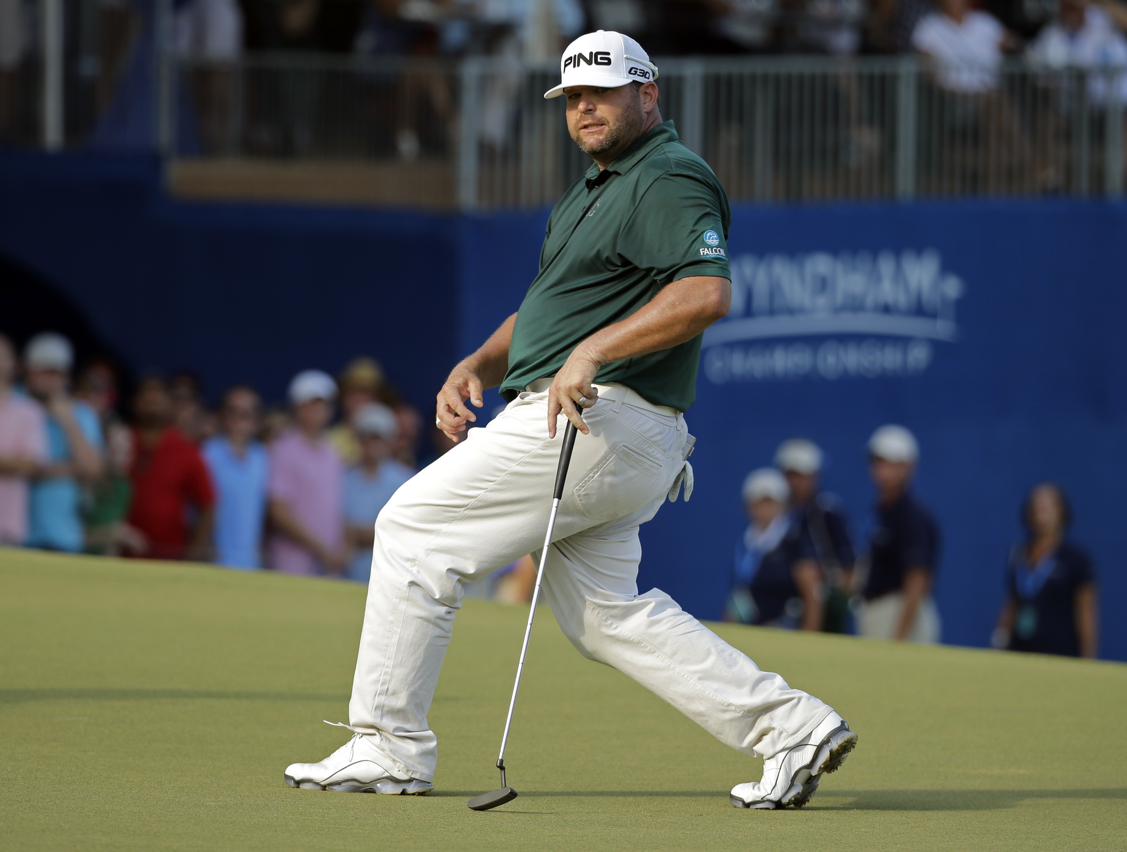 Jason Gore reacts after missing a birdie putt on the 18th hole that would have tied him with the leader during the final round of the Wyndham Championship golf tournament at Sedgefield Country Club in Greensboro, N.C., Sunday, Aug. 23, 2015. Davis Love II