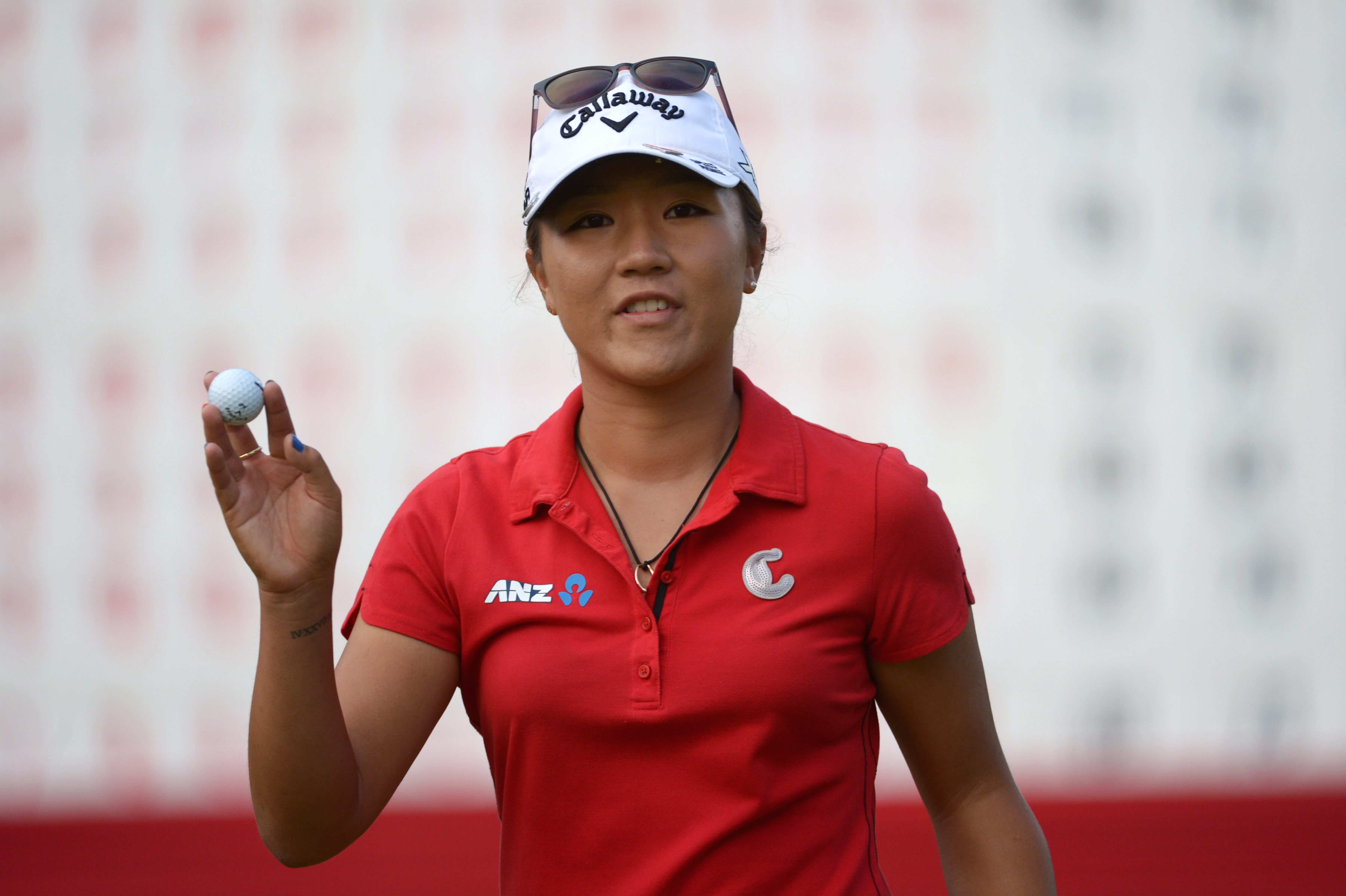 Lydia Ko, of New Zealand, waves to the crowd on the 18th green during the final round of the Canadian Pacific Women's Open golf tournament at Vancouver Golf Club in Coquitlam, British Columbia, on Sunday, Aug. 23, 2015. (Jonathan Hayward/The Canadian Pres