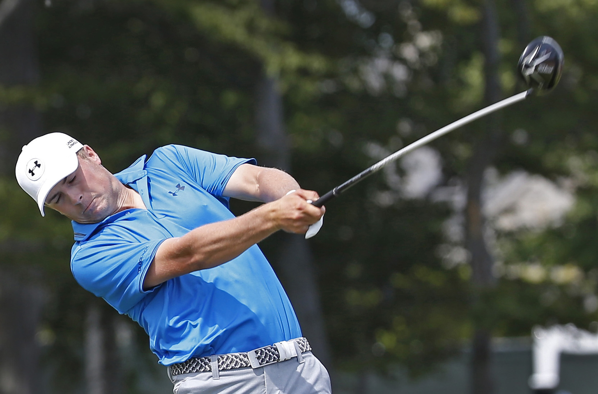 Jordan Spieth hits a drive on the first hole during the fourth round of the PGA Championship golf tournament Sunday, Aug. 16, 2015, at Whistling Straits in Haven, Wis. (AP Photo/Julio Cortez)