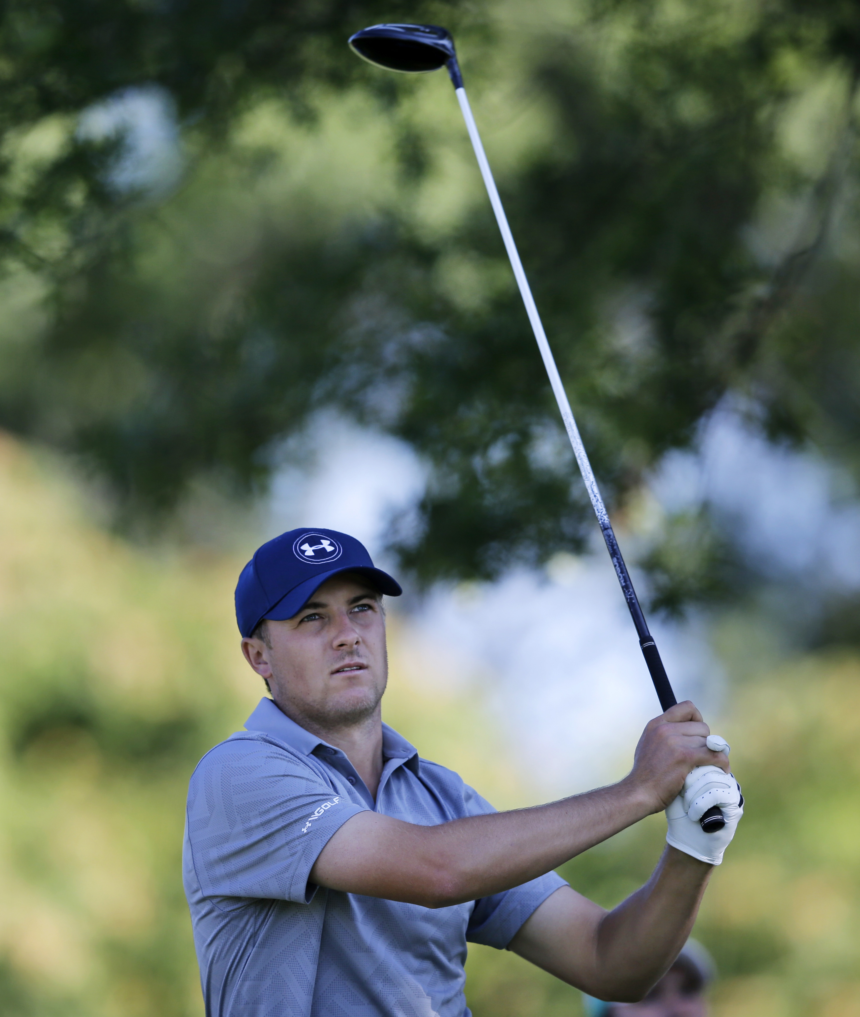 Jordan Spieth hits a tee shot on the 12th hole during the first round of play at The Barclays golf tournament Thursday, Aug. 27, 2015, in Edison, N.J. (AP Photo/Mel Evans)