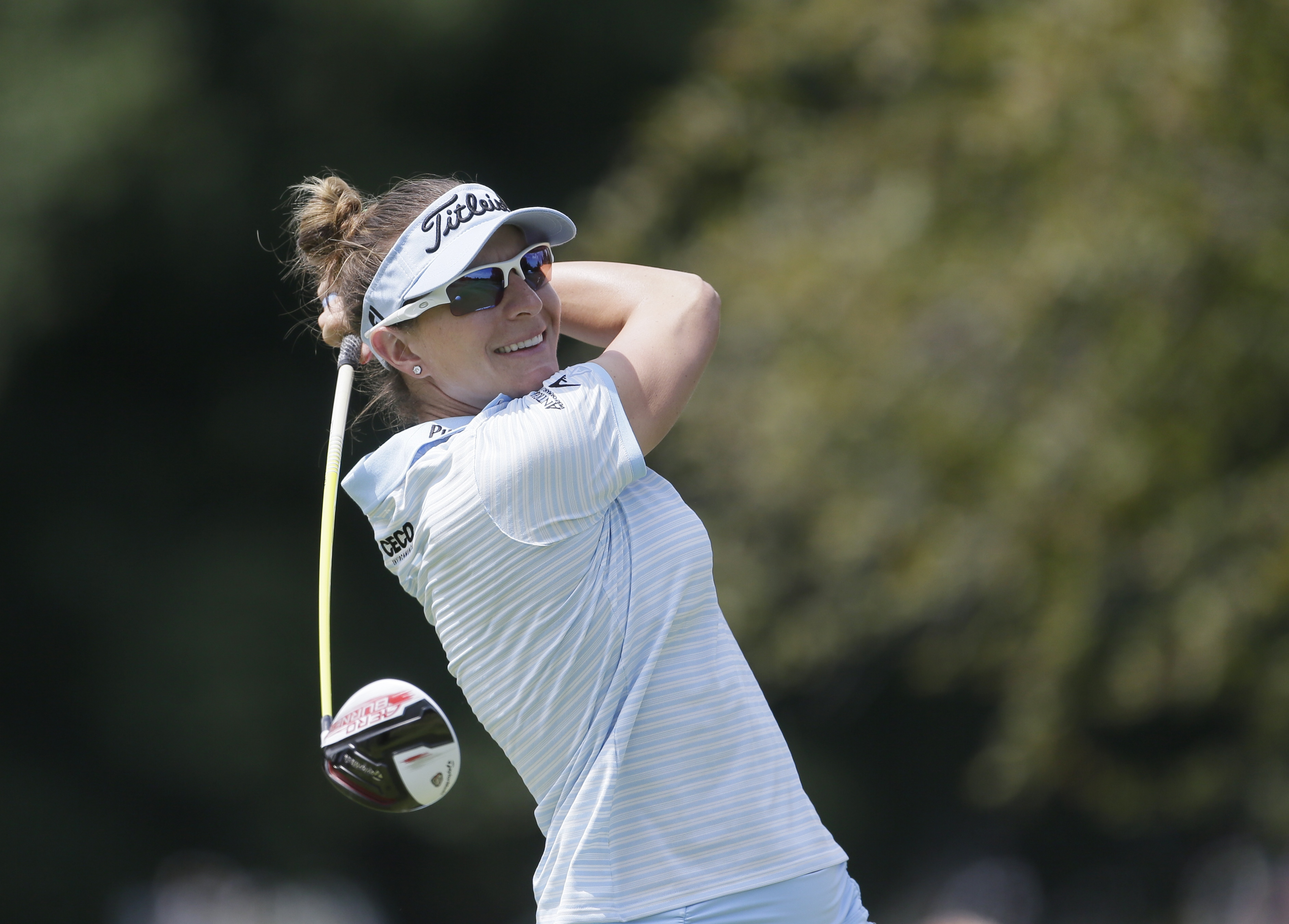 Brittany Lang drives on the 16th hole during the final round of the Meijer LPGA Classic golf tournament at Blythefield Country Club, Sunday, July 26, 2015 in Belmont, Mich. (AP Photo/Carlos Osorio)