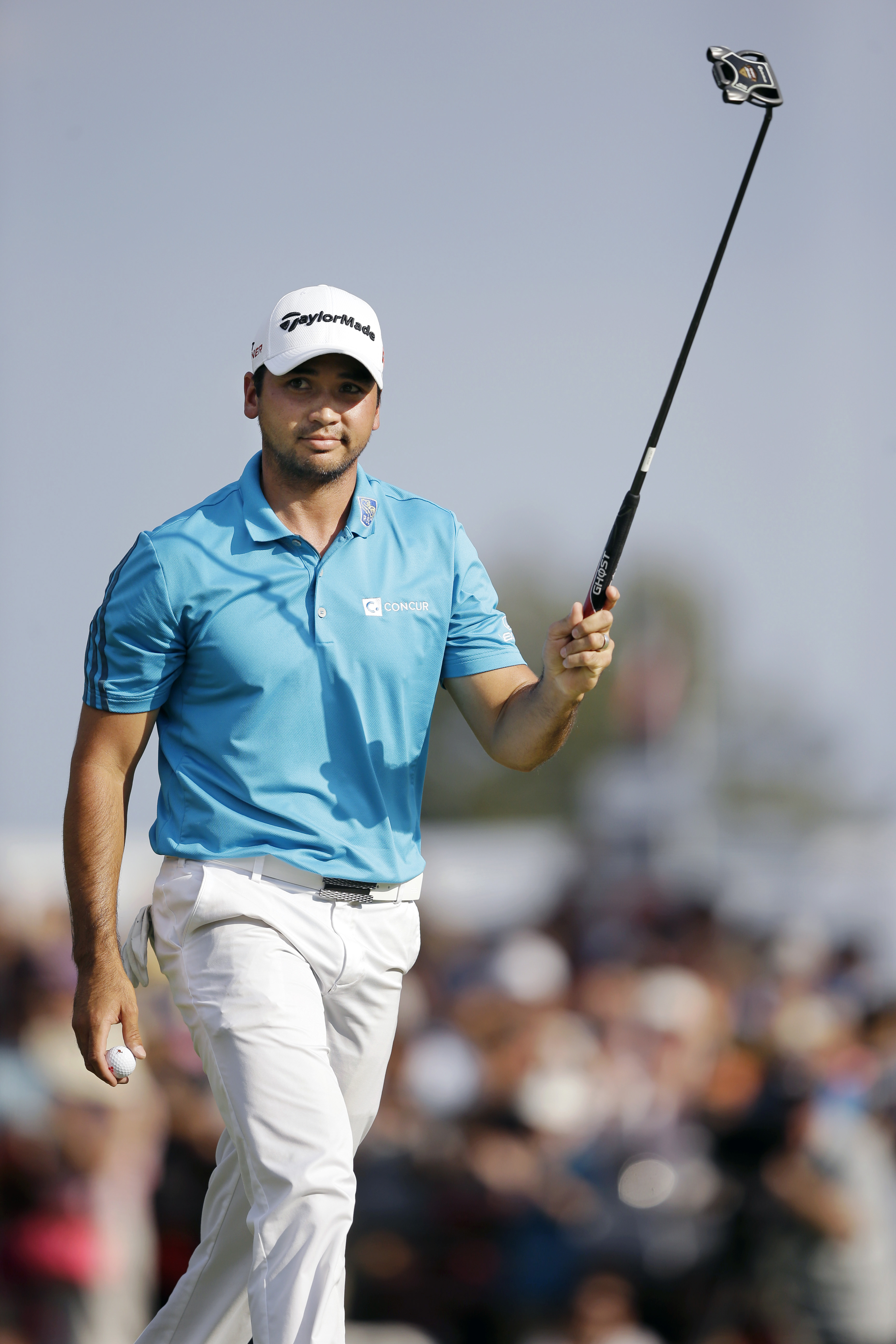 Jason Day, of Australia waves his club after hitting his putt on the 18th hole during the third round of play at The Barclays golf tournament Saturday, Aug. 29, 2015, in Edison, N.J. (AP Photo/Mel Evans)