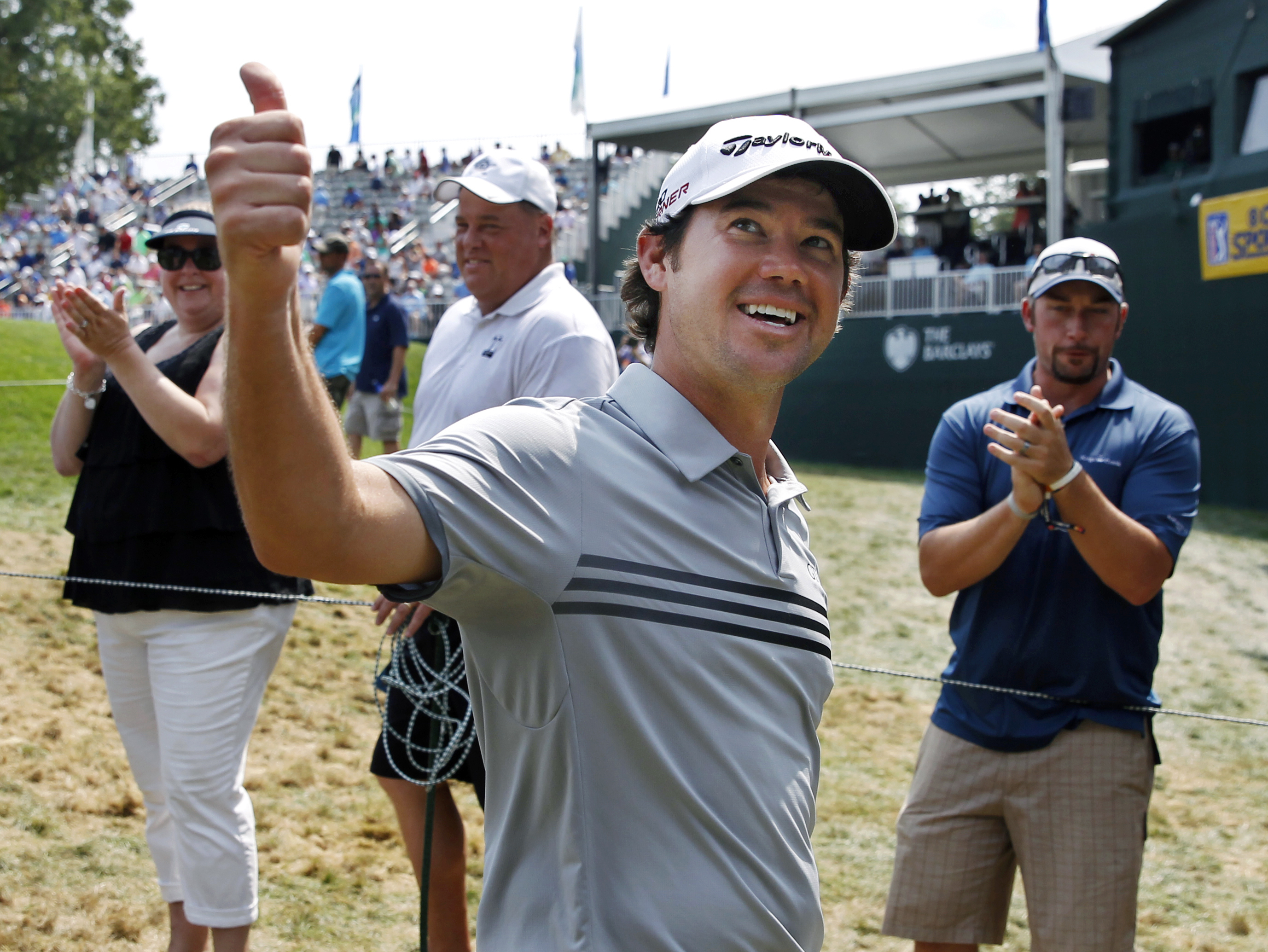 Brian Harman gives thumbs-up to a cheering gallery as he walks off the 18th hole after finishing with two holes-in-one in the final round of play at The Barclays golf tournament Sunday, Aug. 30, 2015, in Edison, N.J. Harman hit a hole-in-one on the third