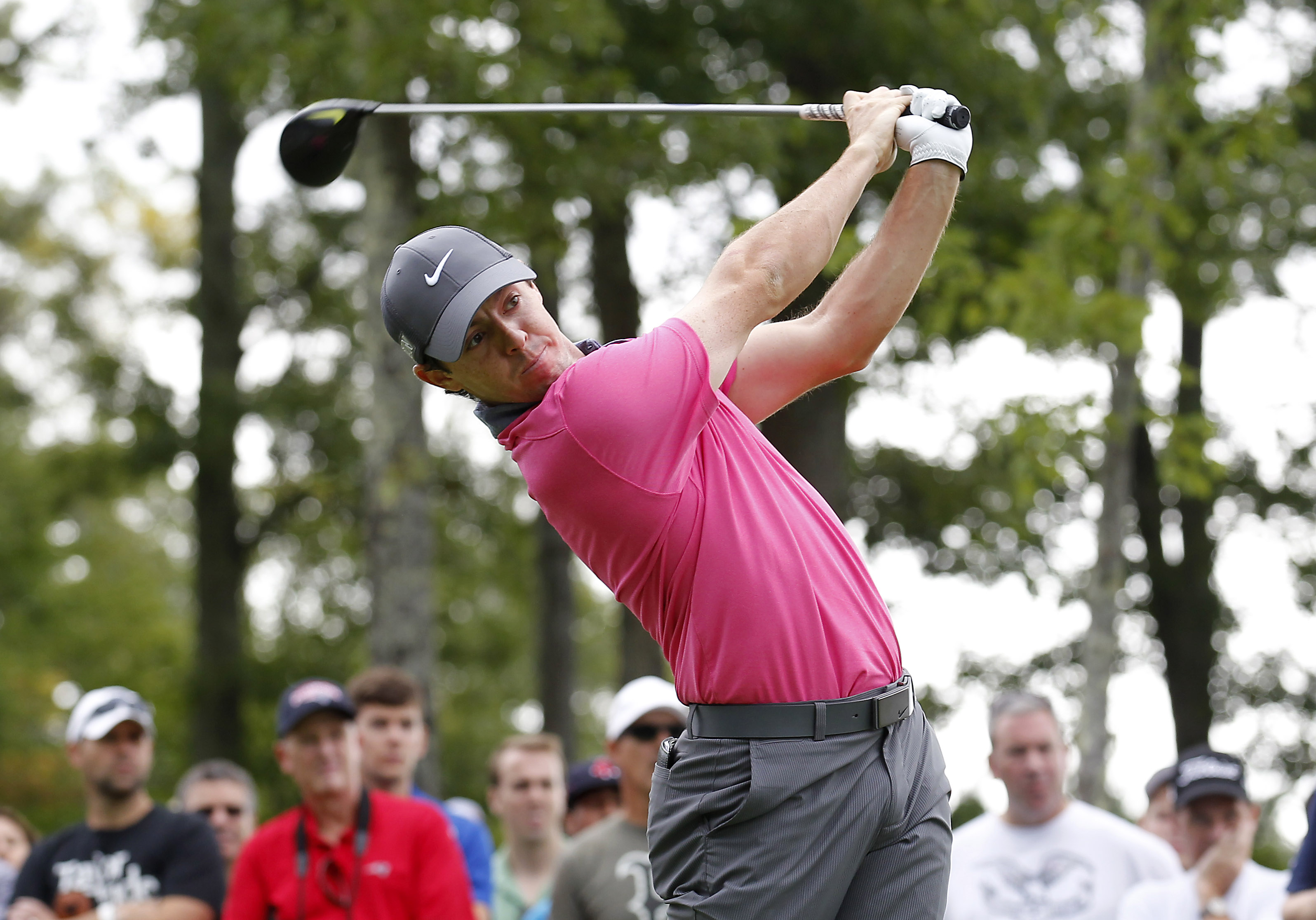 Rory McIlroy, from Northern Ireland, hits his tee shot on the 12th hole during the first round of the Deutsche Bank Championship golf tournament in Norton, Mass., Friday, Sept. 4, 2015. (AP Photo/Stew Milne)