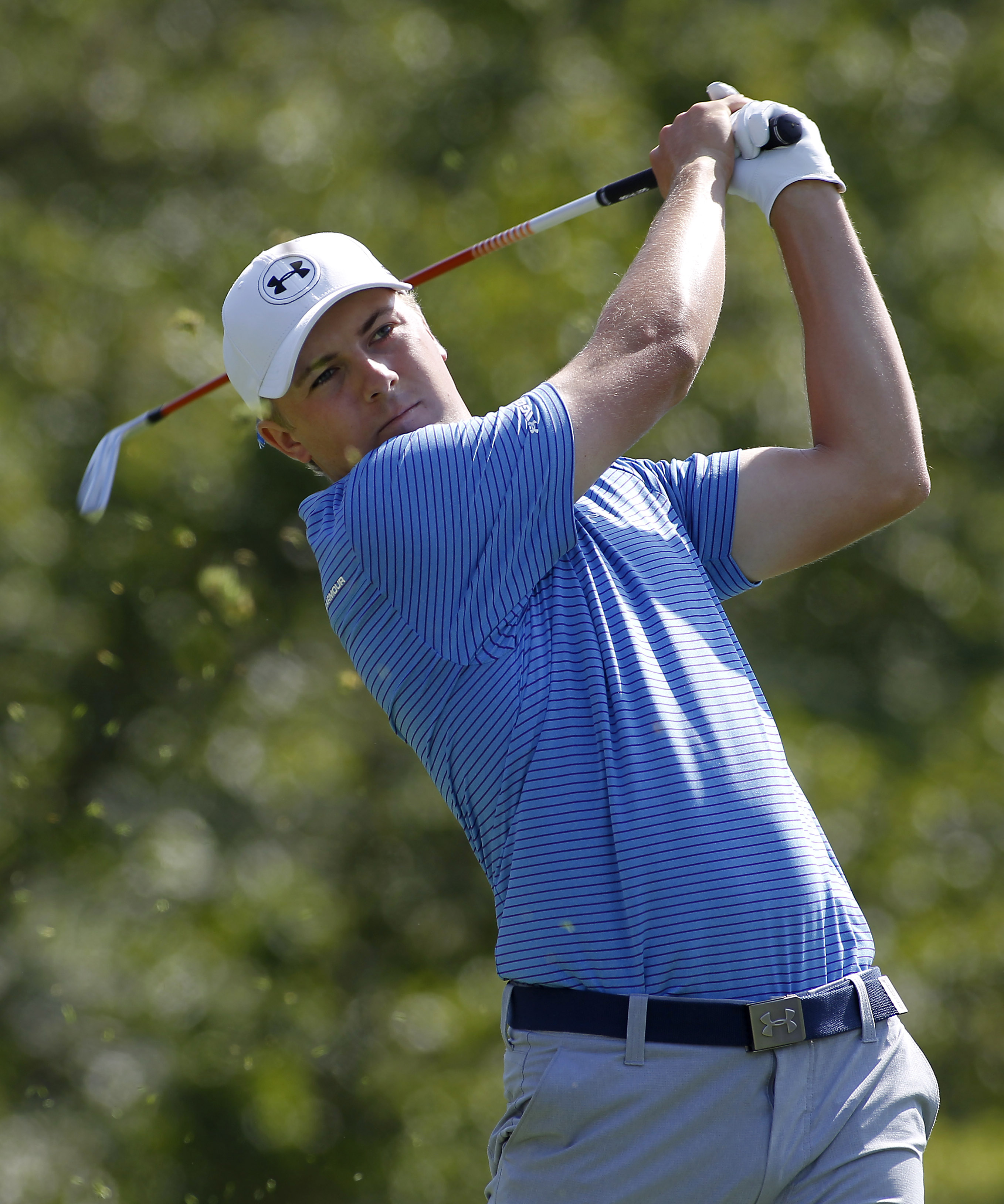 Jordan Spieth hits his tee shot on the 17th hole during the first round of the Deutsche Bank Championship golf tournament in Norton, Mass., Friday, Sept. 4, 2015. (AP Photo/Stew Milne)