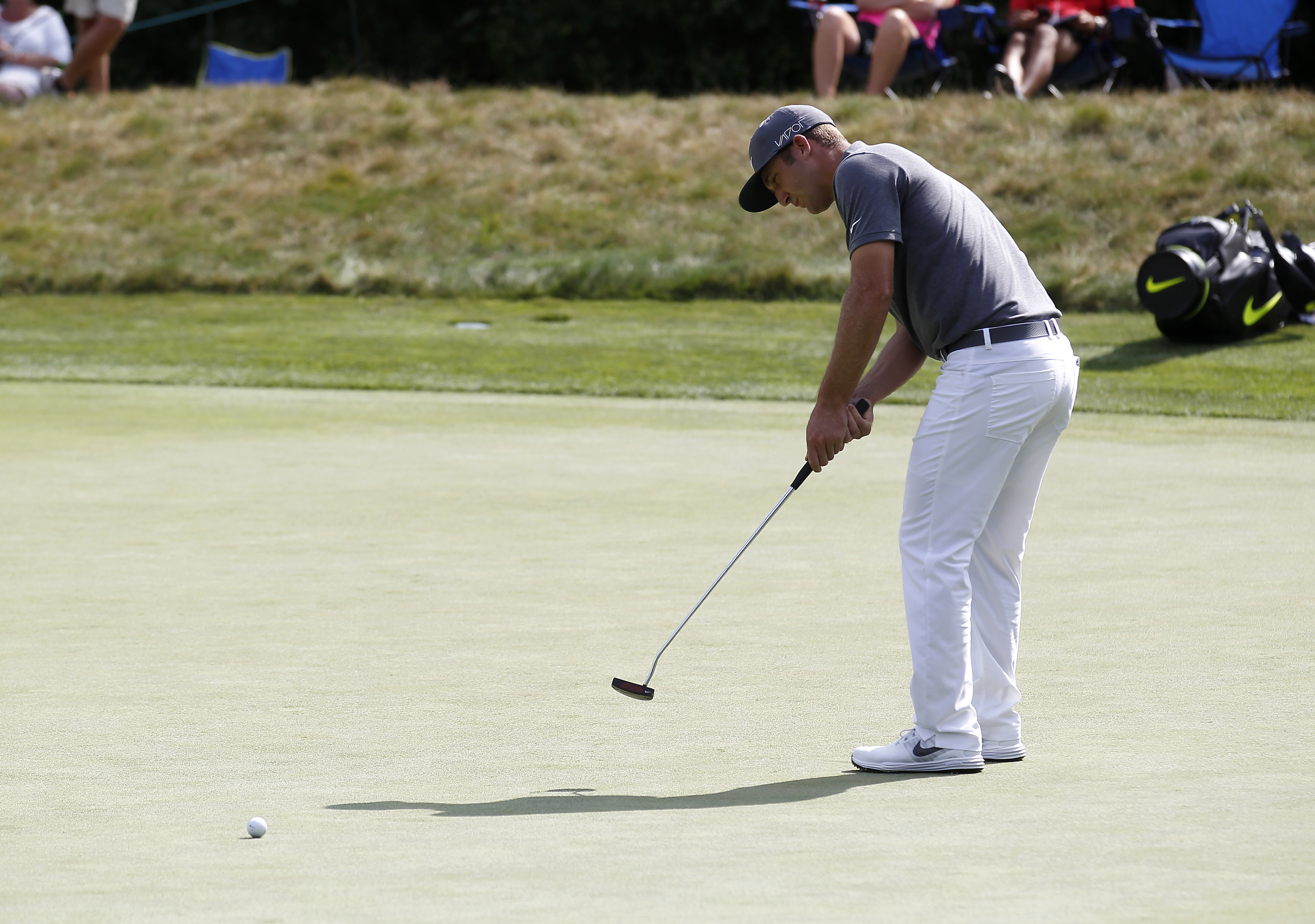 Kevin Chappell putts on the ninth hole during the first round of the Deutsche Bank Championship golf tournament in Norton, Mass., Friday, Sept. 4, 2015. (AP Photo/Stew Milne)