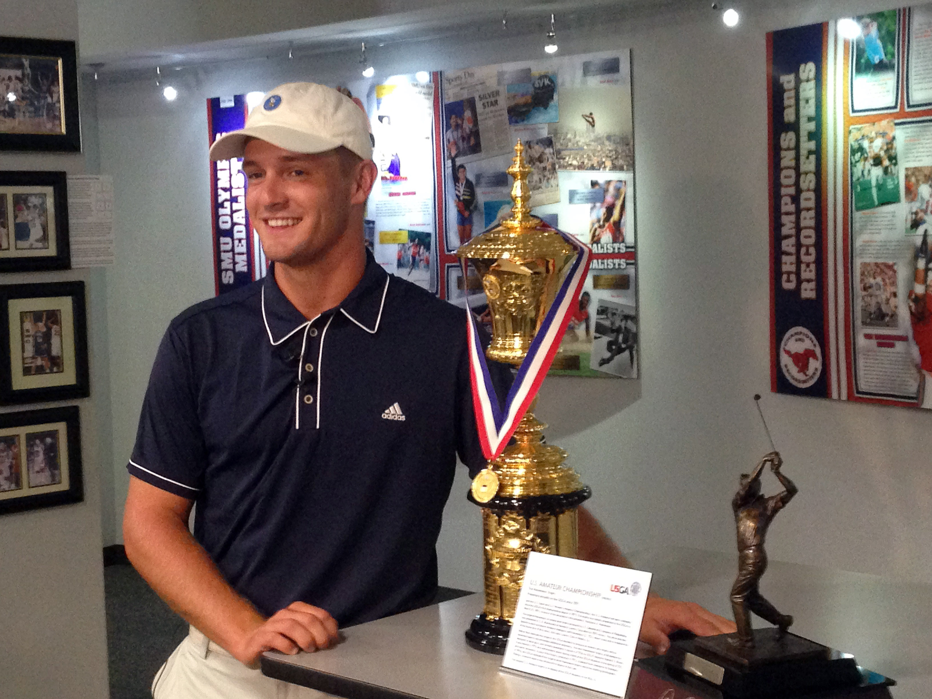 ADVANCE FOR WEEKEND EDITIONS, SEPT. 12-13 - Bryson DeChambeau is photographed with the U.S. Amateur Championship trophy at SMU's athletic Hall of Fame on Aug. 26, 2015 in Dallas. DeChambeau is a physics major with a unique mental approach to golf, and iro