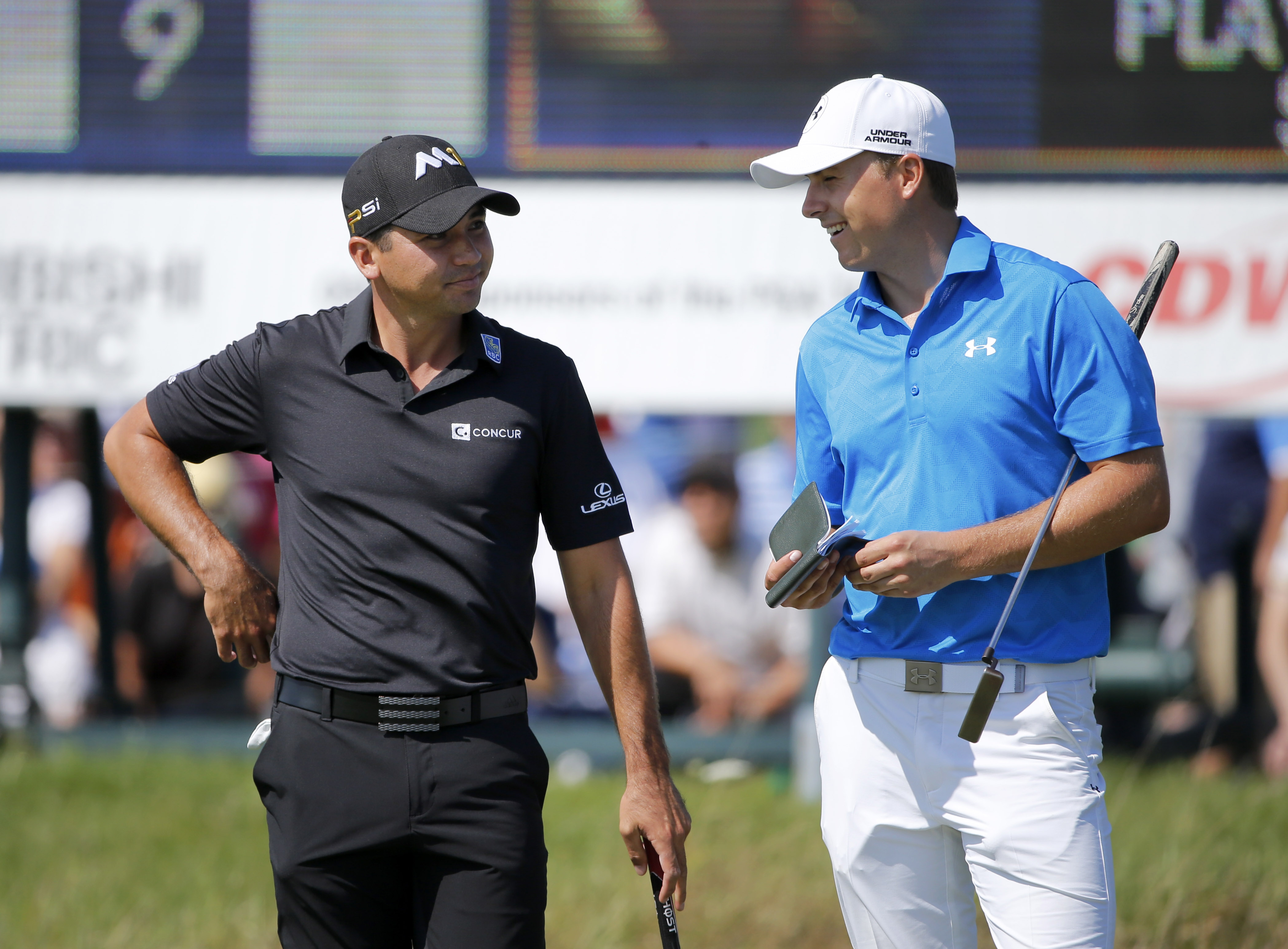 Jason Day, left, of Australia,  talks with Jordan Spieth on the 10th green, during the first round of the BMW Championship golf tournament at Conway Farms Golf Club, Thursday, Sept. 17, 2015, in Lake Forest, Ill. (AP Photo/Charles Rex Arbogast)