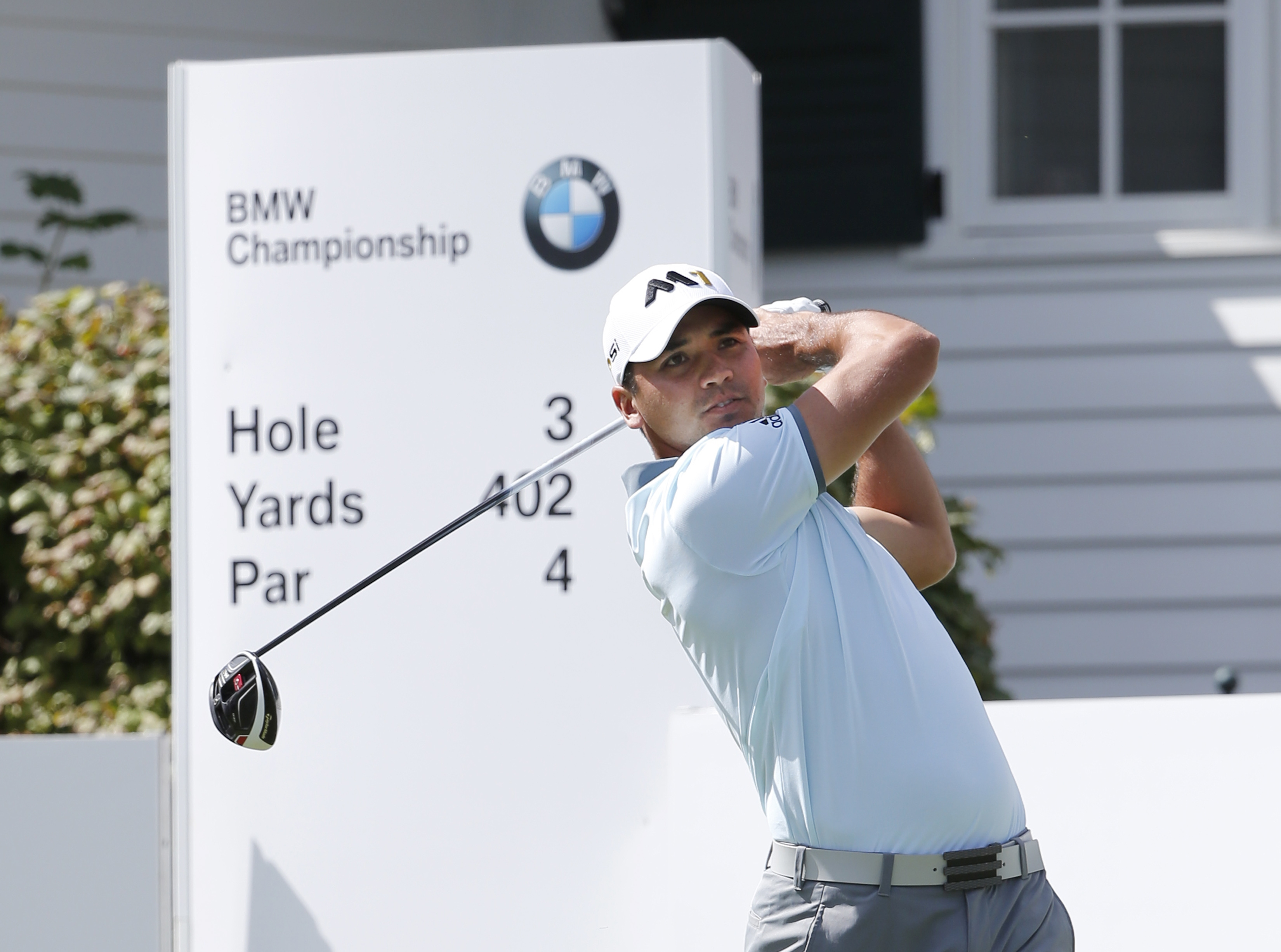 Jason Day,, of Australia, watches his tee shot on the third hole during the third round of the BMW Championship golf tournament at Conway Farms Golf Club, Saturday, Sept. 19, 2015, in Lake Forest, Ill. (AP Photo/Charles Rex Arbogast)