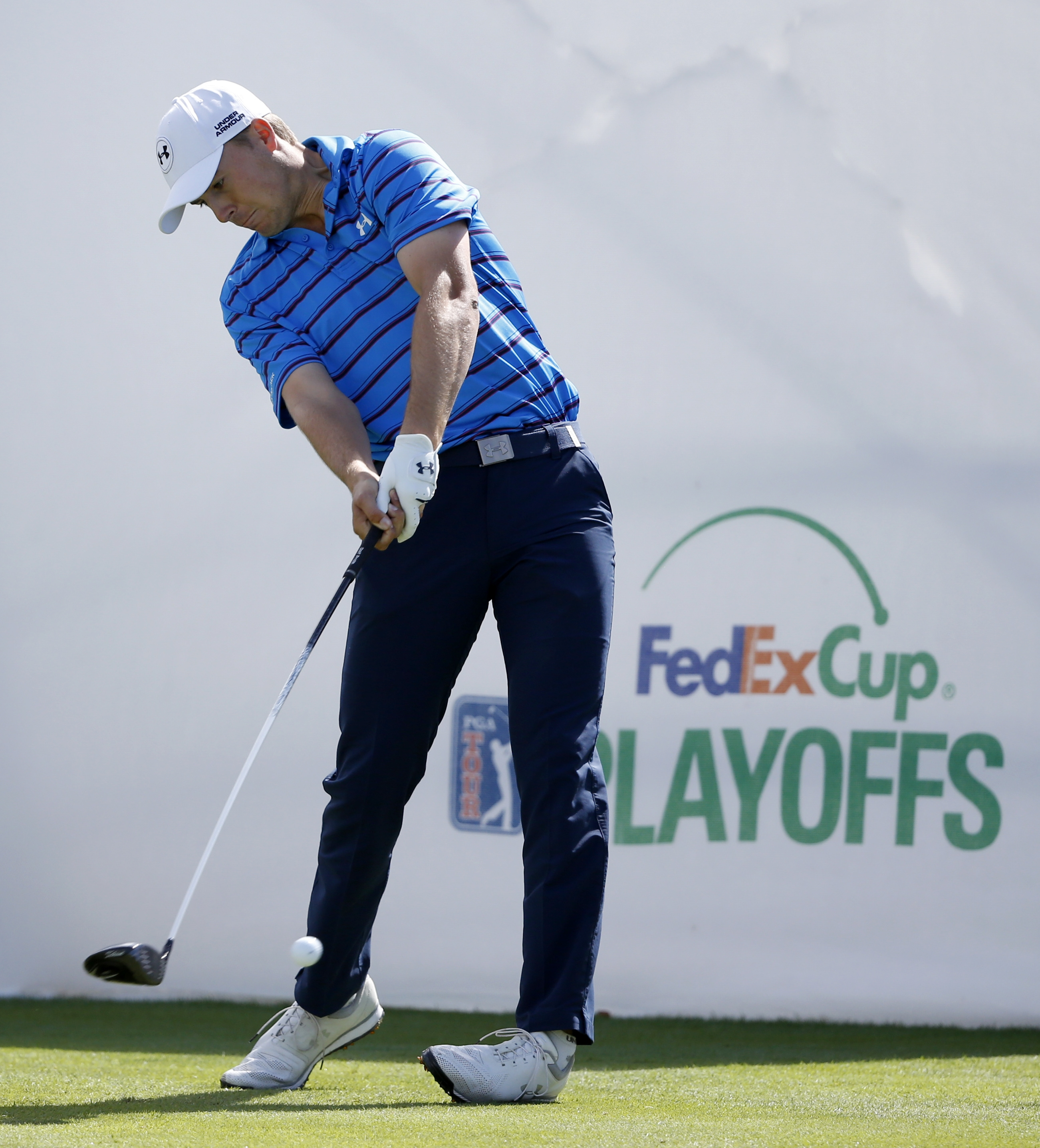 Jordan Spieth hits his tee shot on the first hole during the third round of the BMW Championship golf tournament at Conway Farms Golf Club, Saturday, Sept. 19, 2015, in Lake Forest, Ill. (AP Photo/Charles Rex Arbogast)