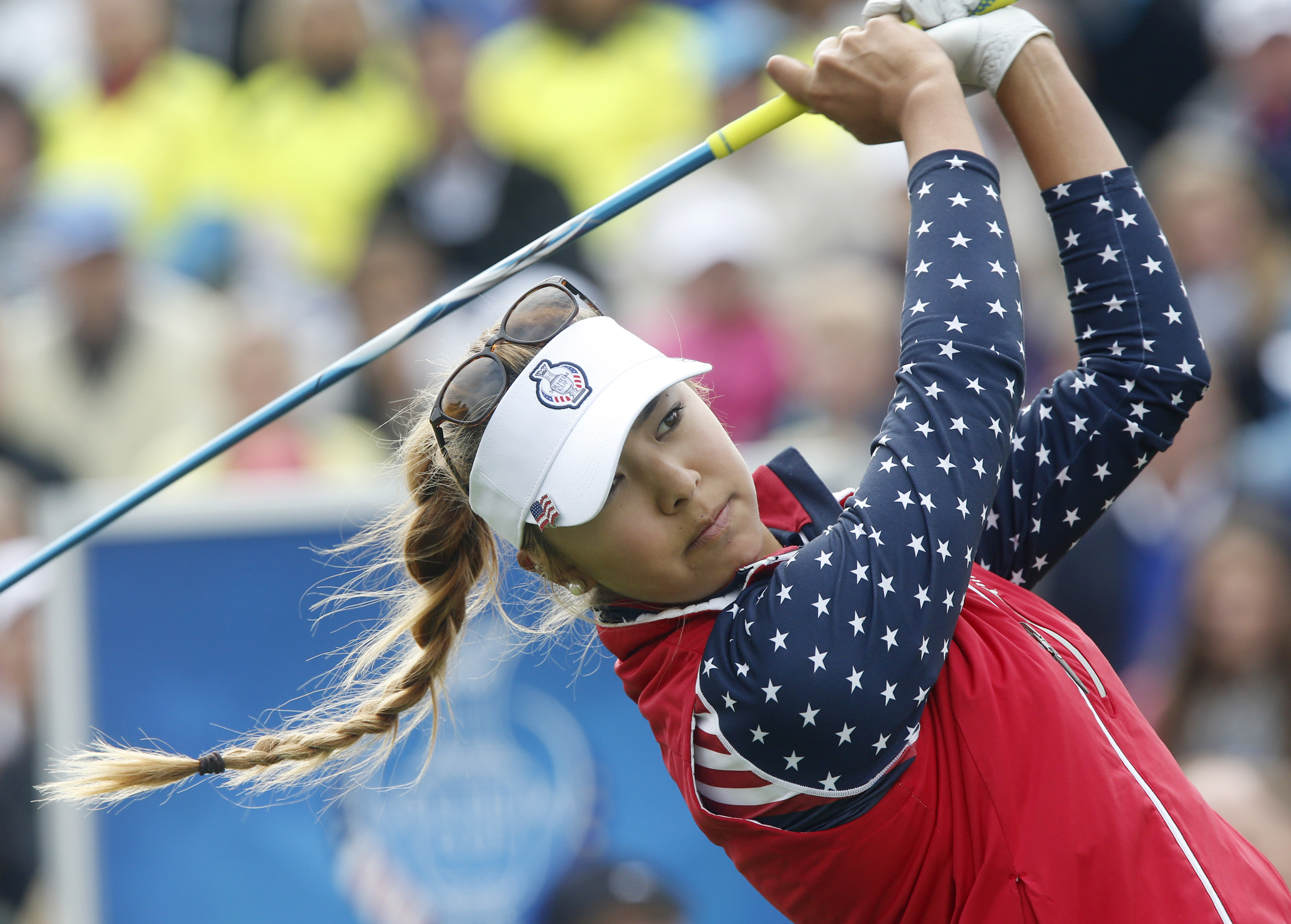 United States' Alison Lee tees off in the singles matches on Day3 of the Golf Solheim Cup in St.Leon-Rot, Germany, Sunday, Sept. 20, 2015.(AP Photo/Michael Probst)