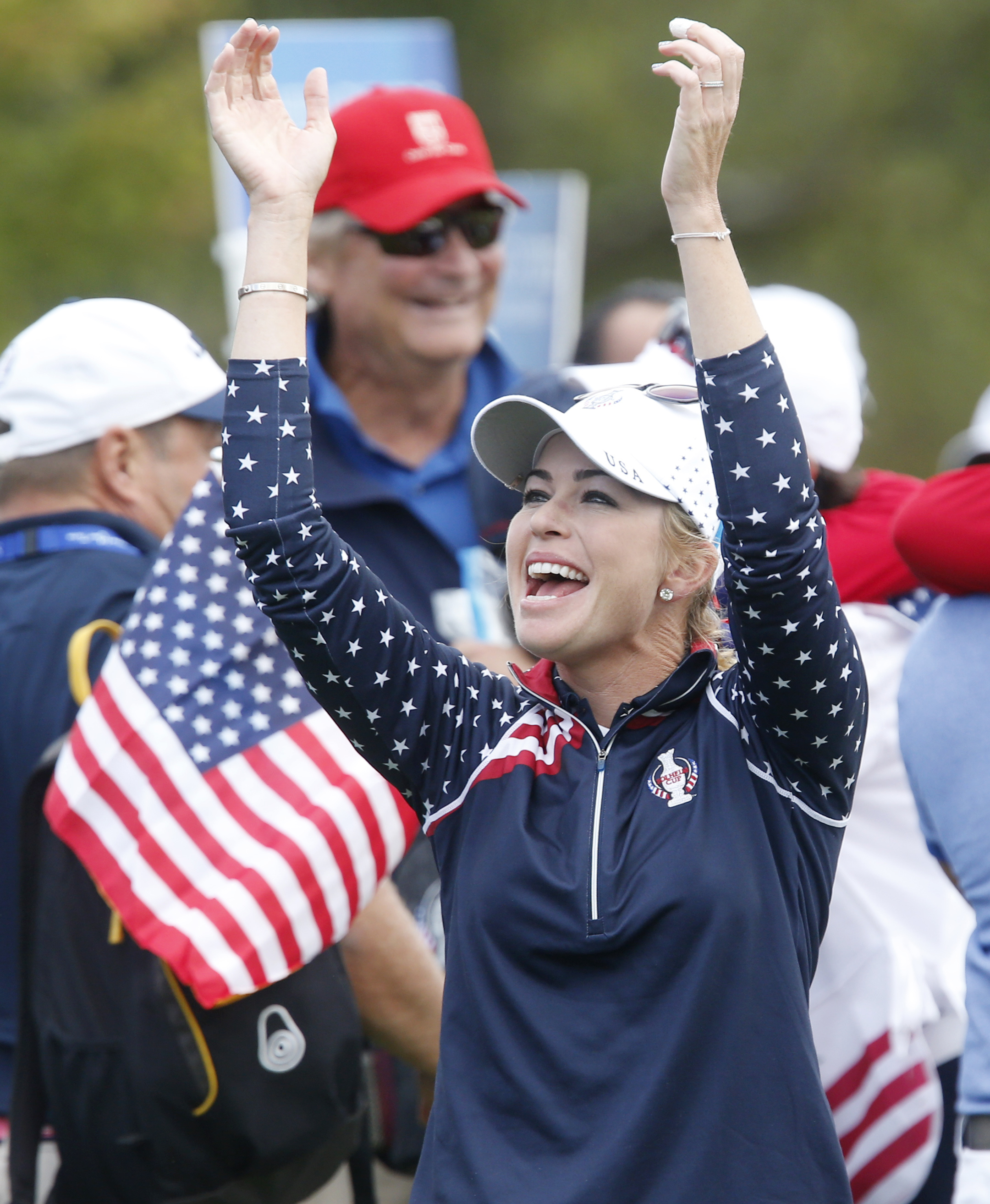 U.S. golfer Paula Creamer celebrates after she made the final point on Day3 of the Golf Solheim Cup in St.Leon-Rot, Germany, Sunday, Sept. 20, 2015.  Paula Creamer defeated Germany's Sandra Gal to complete a remarkable comeback as United States won the So