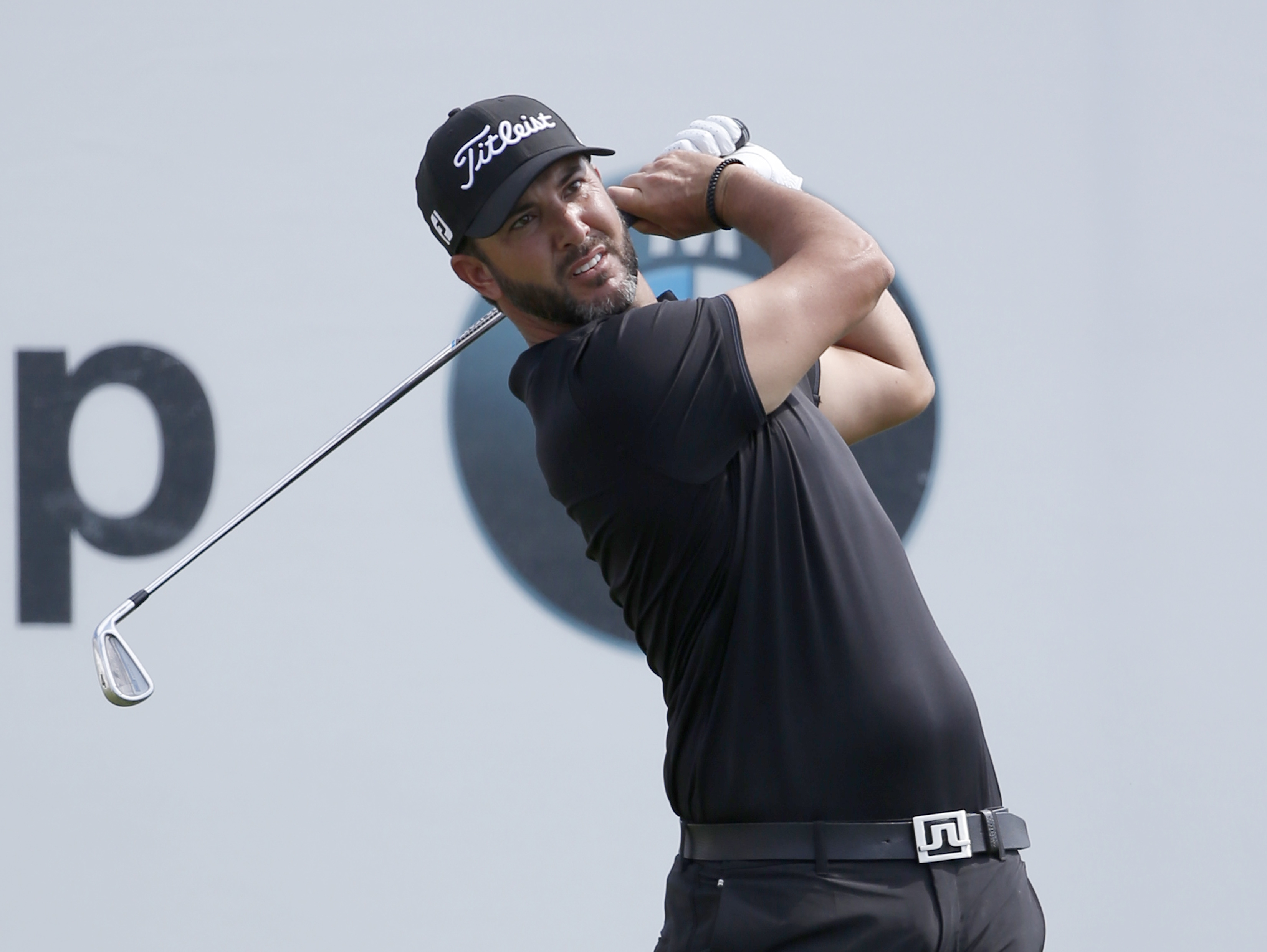 Scott Piercy watches his tee shot on the first hole during the third round of the BMW Championship golf tournament at Conway Farms Golf Club, Sunday, Sept. 20, 2015, in Lake Forest, Ill. (AP Photo/Charles Rex Arbogast)