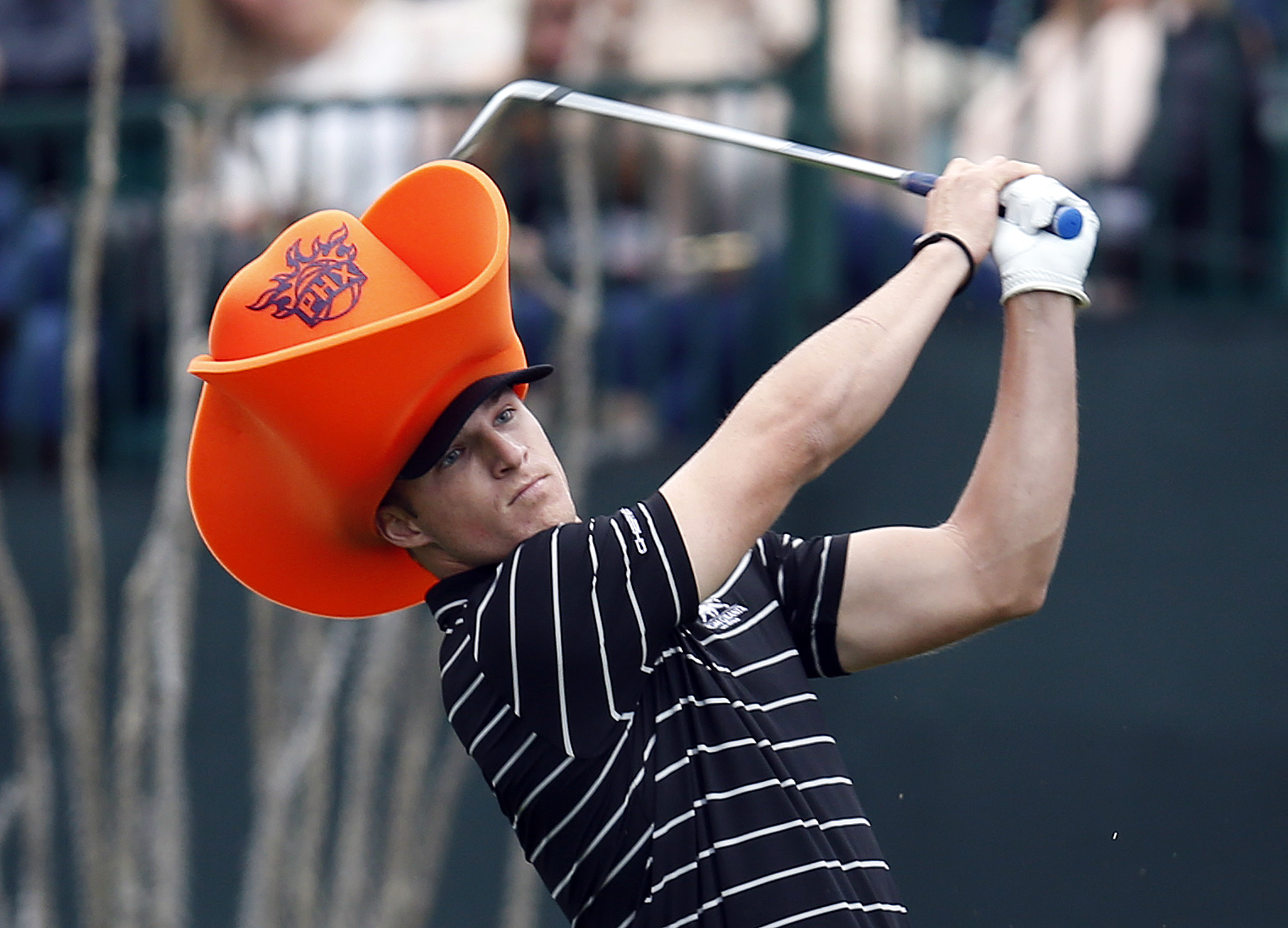 Chez Reavie tees off on the 16th hole during the first round of the Phoenix Open golf tournament, Thursday, Jan. 29, 2015, in Scottsdale, Ariz. (AP Photo/Rick Scuteri)
