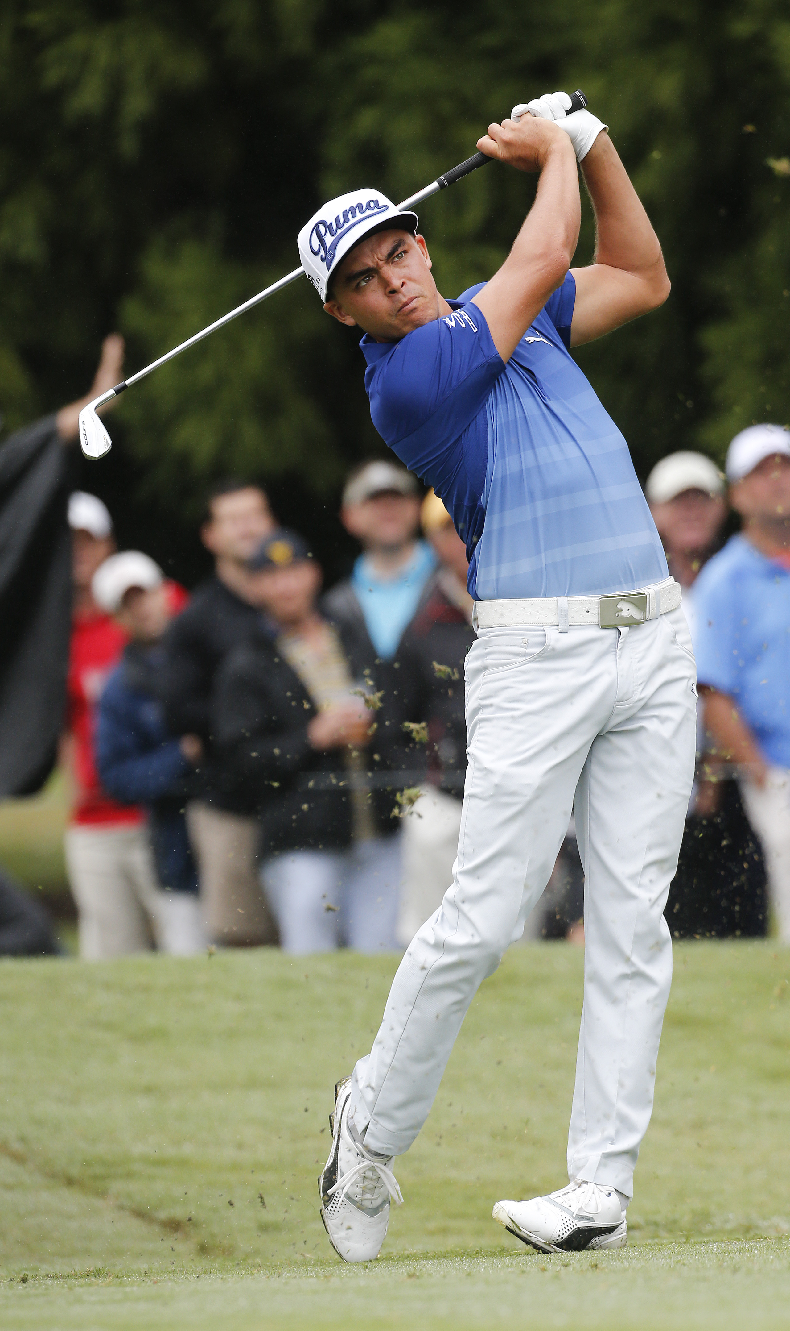 Rickie Fowler hits from the second tee during the second round of the Tour Championship golf tournament at East Lake Club Friday, Sept. 25, 2015, in Atlanta. (AP Photo/ John Bazemore)