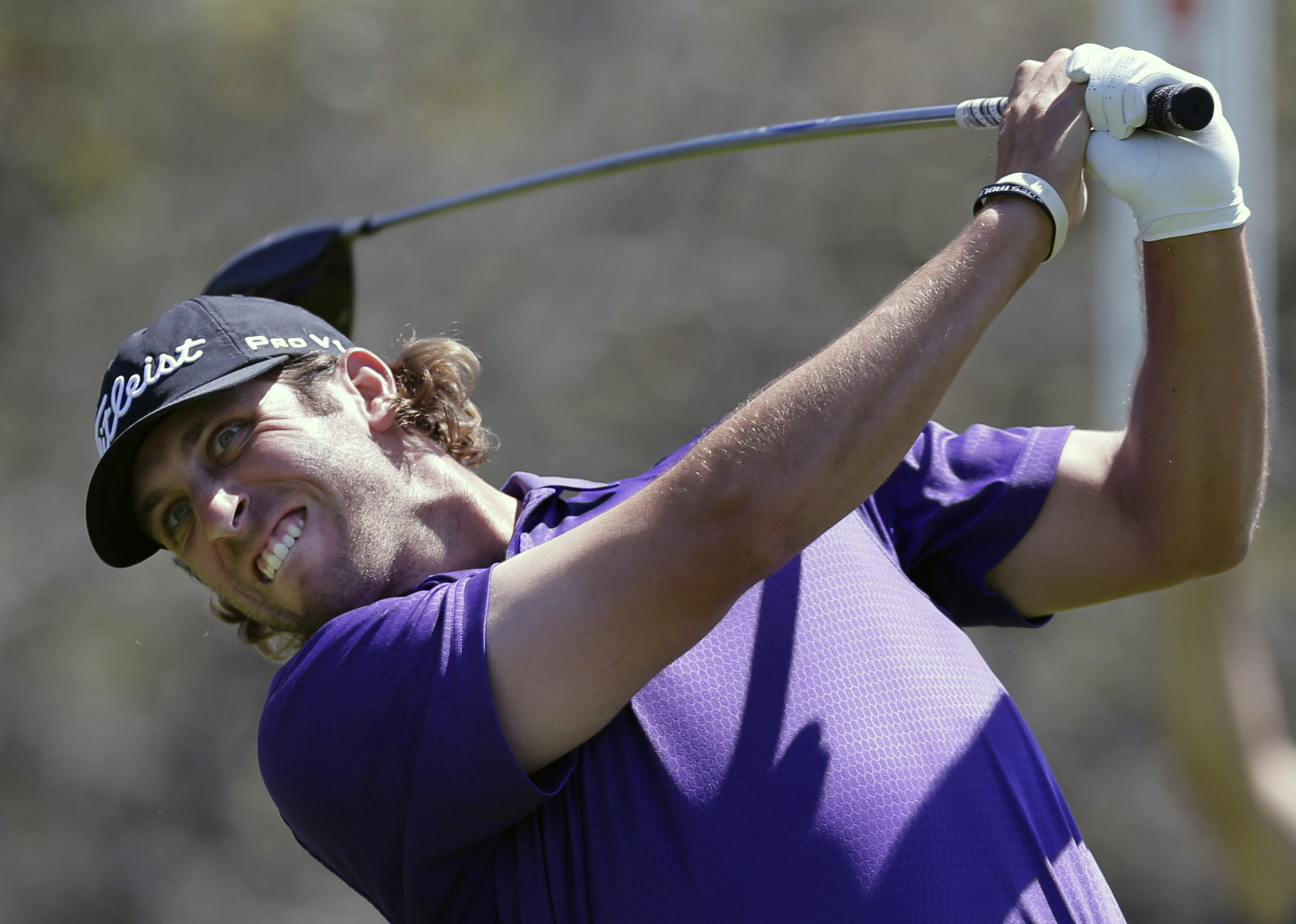 Andrew Loupe hits his drive on the ninth hole during the final round of the Texas Open golf tournament on Sunday, March 30, 2014, in San Antonio. (AP Photo/Eric Gay)