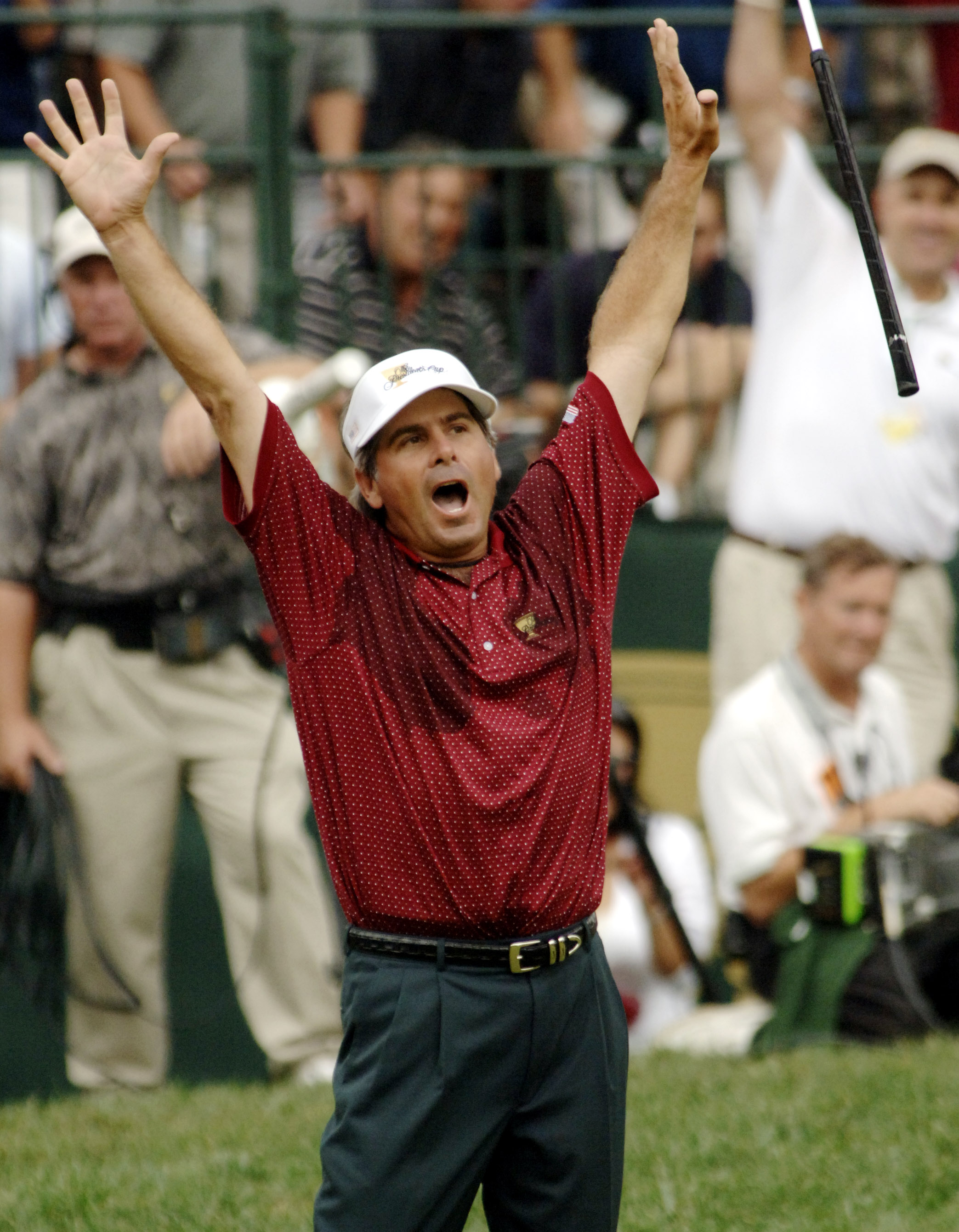 FILE - In this Sept. 25, 2005, file photo, Fred Couples, of the United States, throws his putter after dropping a birdie putt on the 18th hole to beat Vijay Singh, of Fiji, 1-up, in their Presidents Cup singles match at the Robert Trent Jones Golf Club in