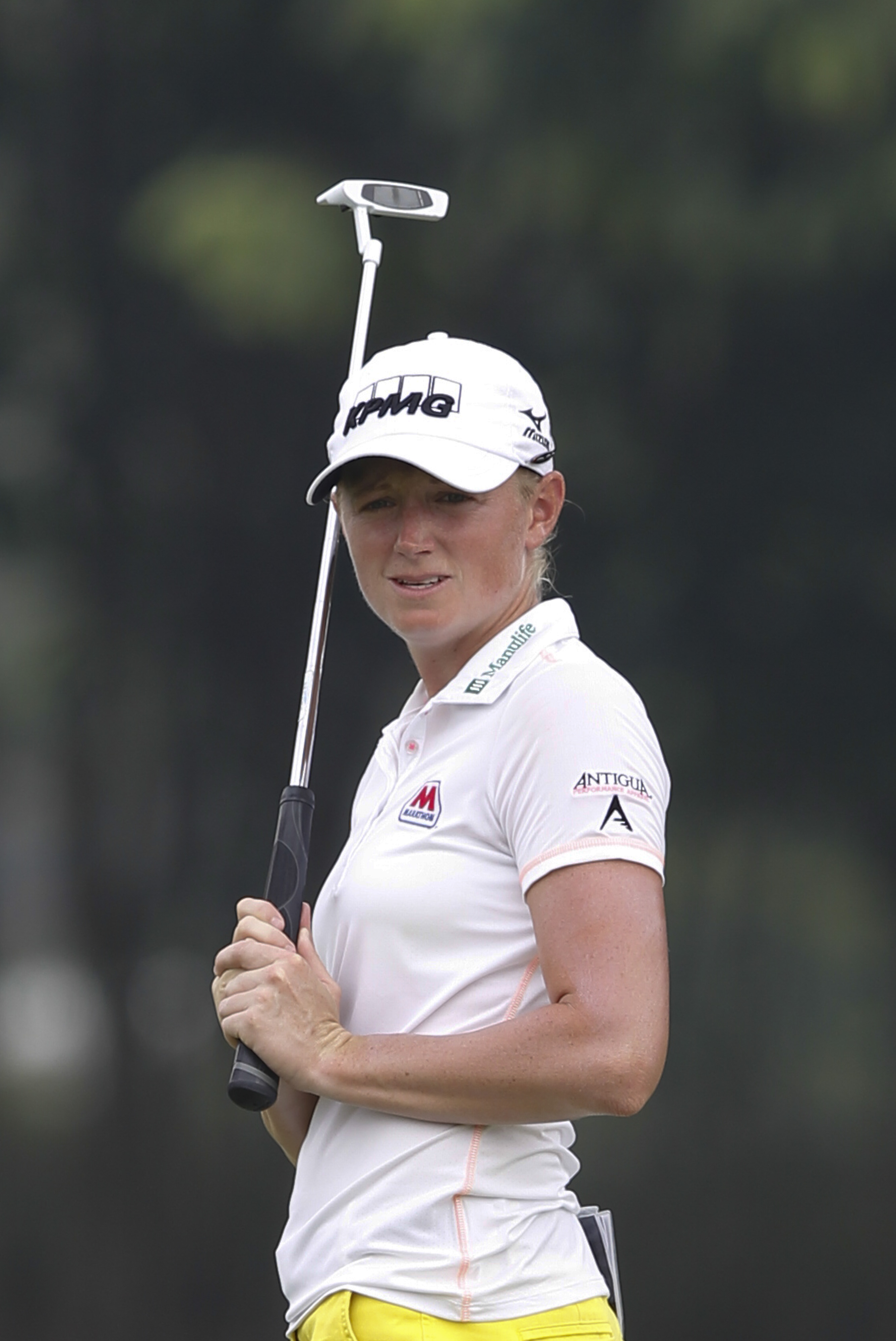 Stacy Lewis of the United States reacts after missing a shot on the sixth green during the first round of the LPGA Malaysia golf tournament at Kuala Lumpur Golf and Country Club in Kuala Lumpur, Malaysia on Thursday, Oct. 8, 2015. (AP Photo/Joshua Paul)