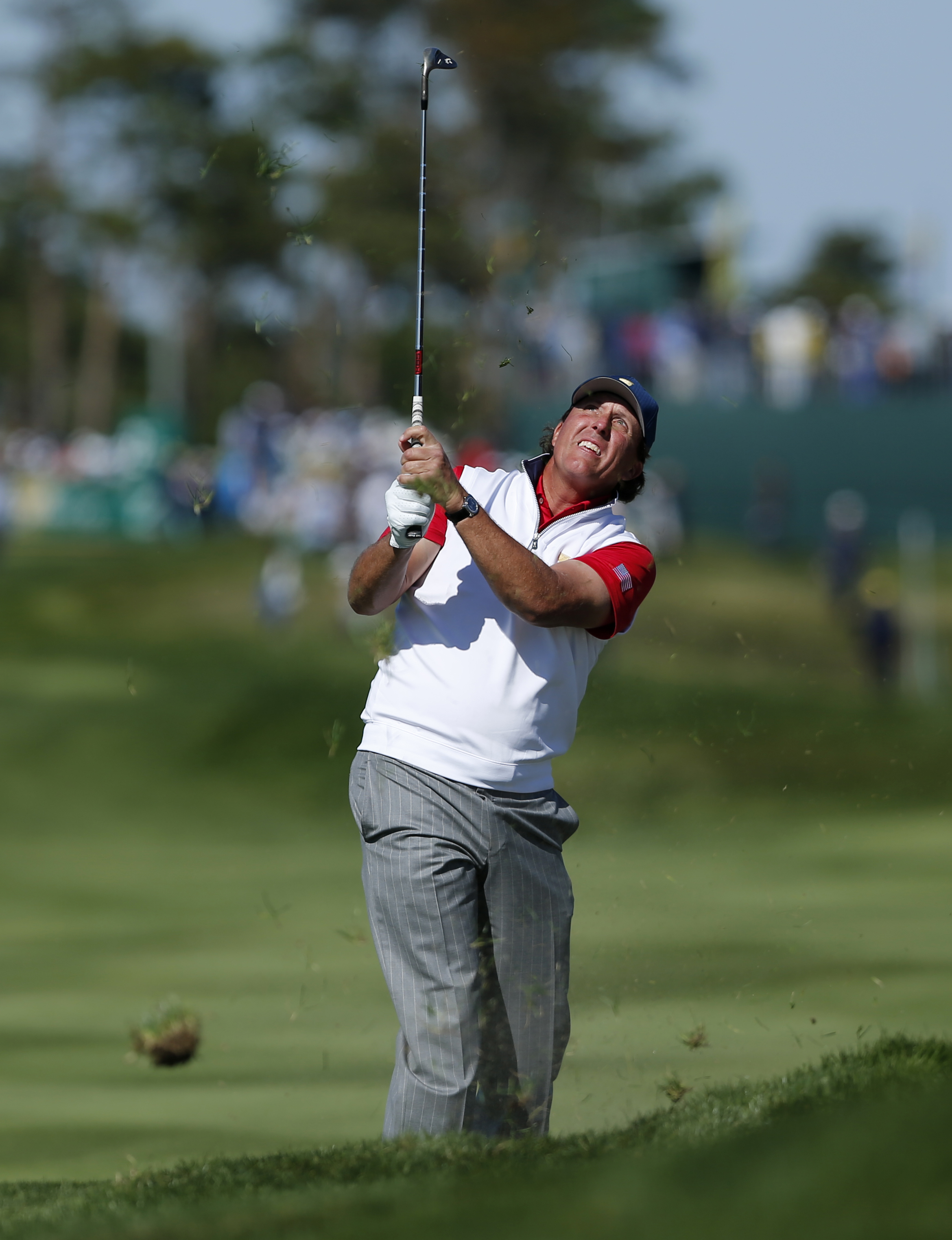 United States' Phil Mickelson hits from the rough on the second hole during his four ball match at the Presidents Cup golf tournament at the Jack Nicklaus Golf Club Korea, in Incheon, South Korea, Friday, Oct. 9, 2015.(AP Photo/Woohae Cho)