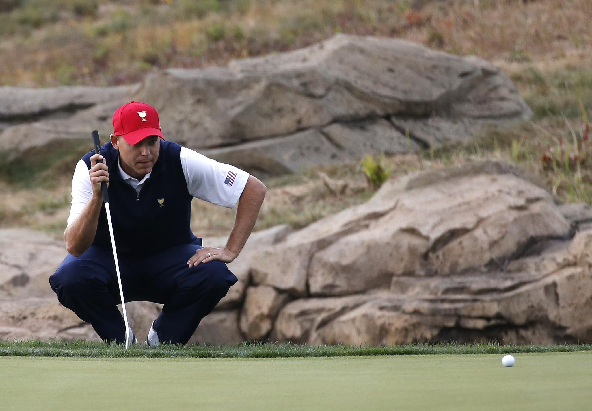 United States' Bill Haas lines up a putt on the fourth green during their foursome match at the Presidents Cup golf tournament at the Jack Nicklaus Golf Club Korea, in Incheon, South Korea, Saturday, Oct. 10, 2015.(AP Photo/Lee Jin-man)