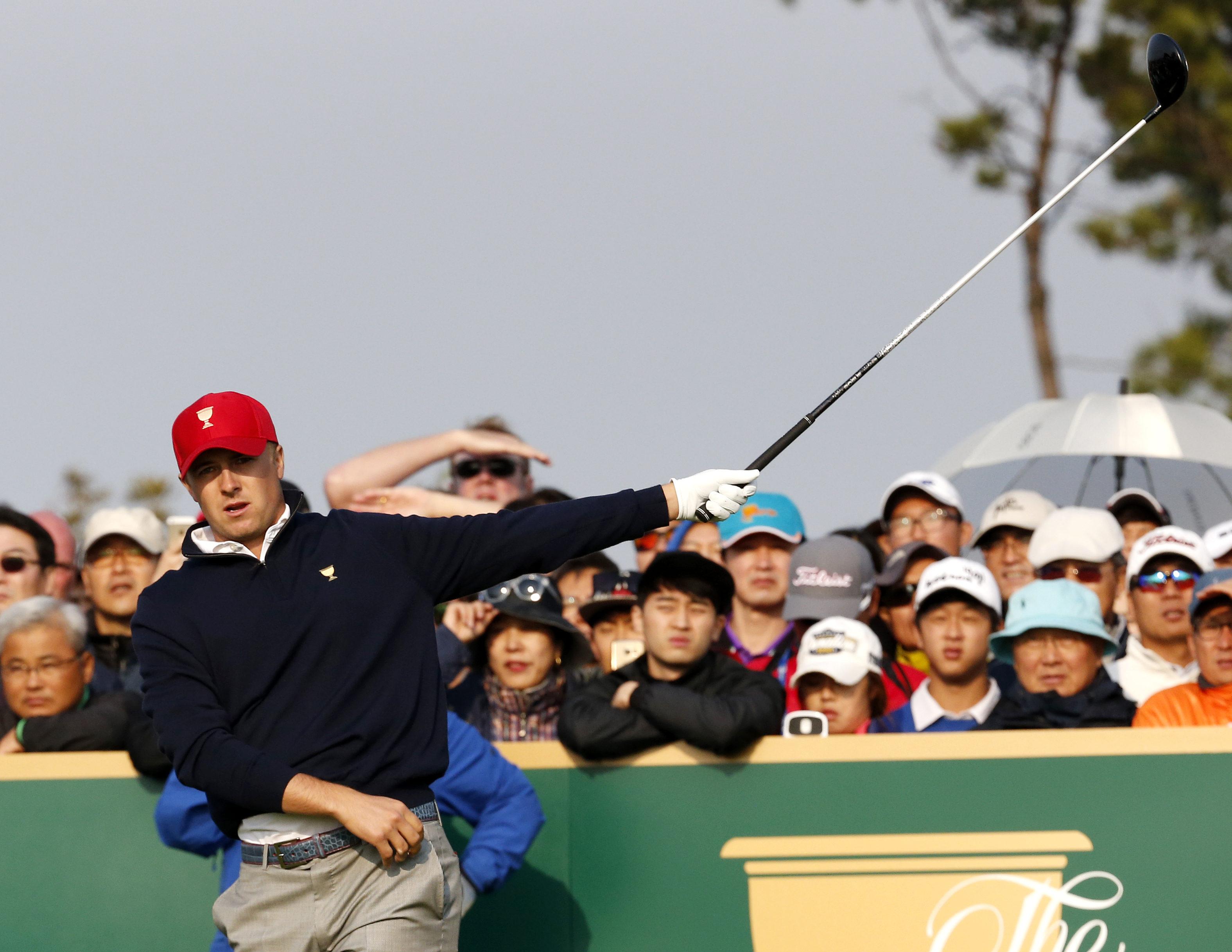 United States' Jordan Spieth reacts after his tee shot on the second hole during his foursome match at the Presidents Cup golf tournament at the Jack Nicklaus Golf Club Korea, in Incheon, South Korea, Saturday, Oct. 10, 2015.(AP Photo/Lee Jin-man)