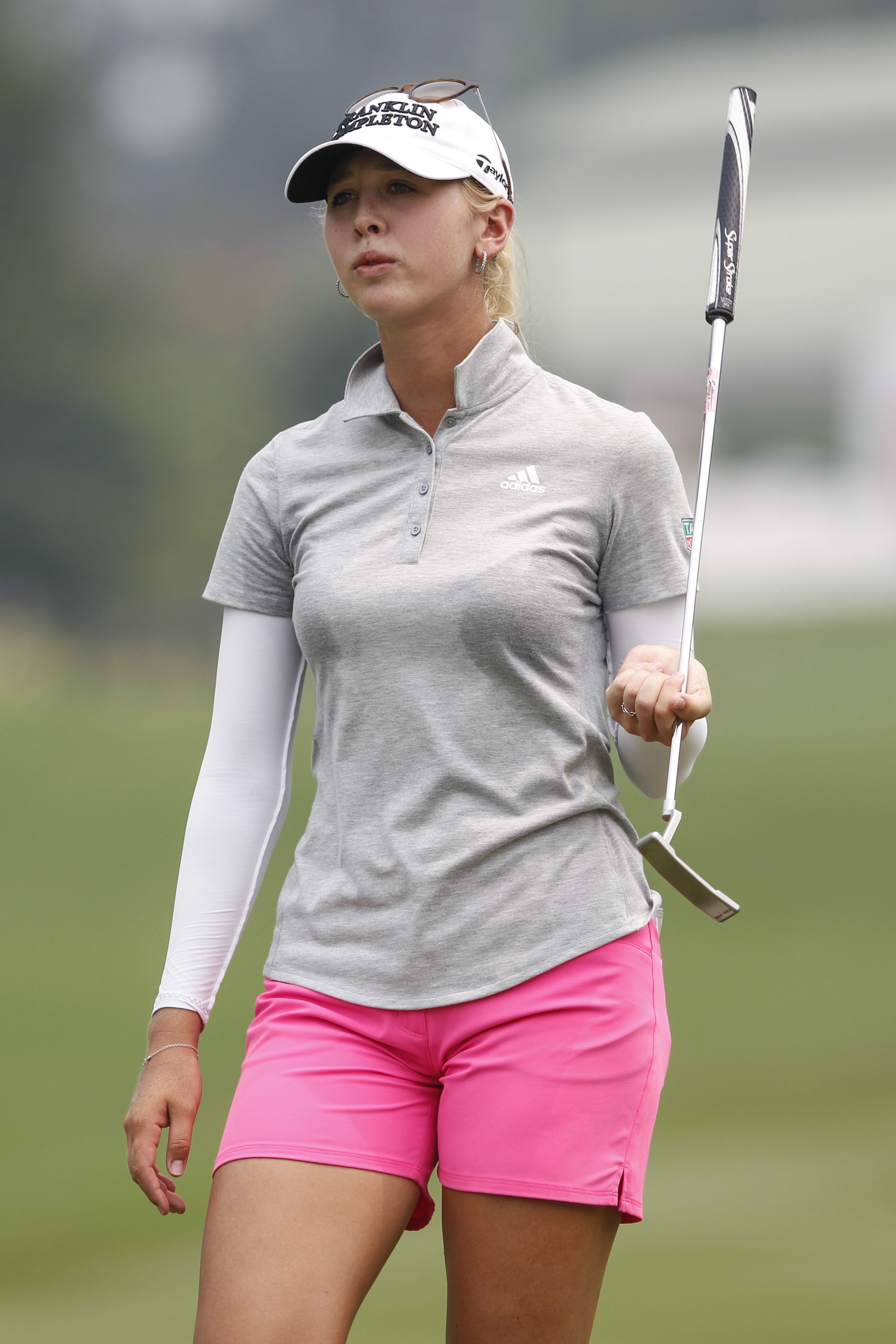 Jessica Korda of the United States swings her putter as she walks towards the 18th green during the third round of the LPGA Malaysia golf tournament at Kuala Lumpur Golf and Country Club in Kuala Lumpur, Malaysia, Saturday, Oct. 10, 2015. (AP Photo/Joshua