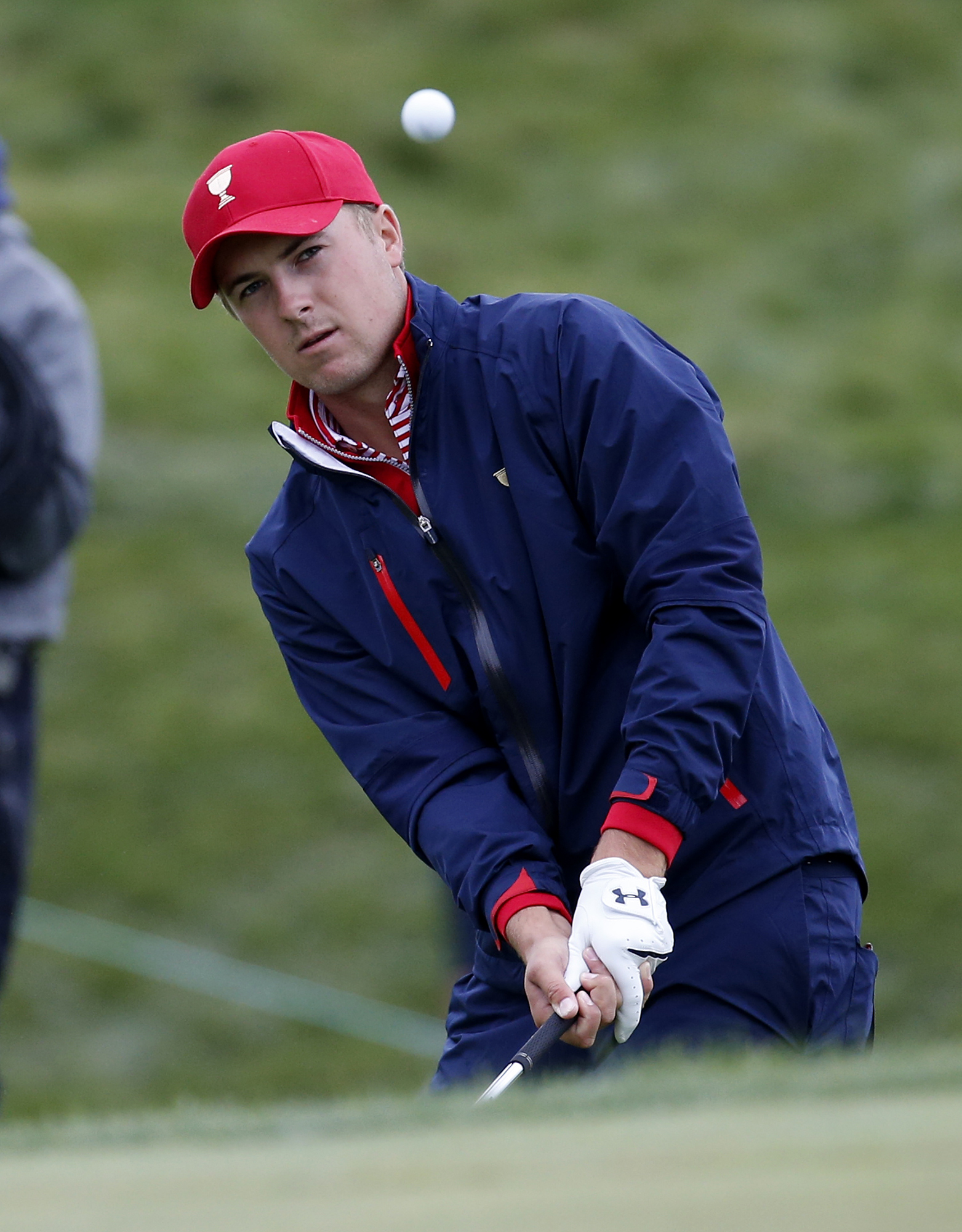 United States' Jordan Spieth plays a chip shot onto the 12th green during his singles match against International team player Marc Leishman of Australia at the Presidents Cup golf tournament at the Jack Nicklaus Golf Club Korea, in Incheon, South Korea, S