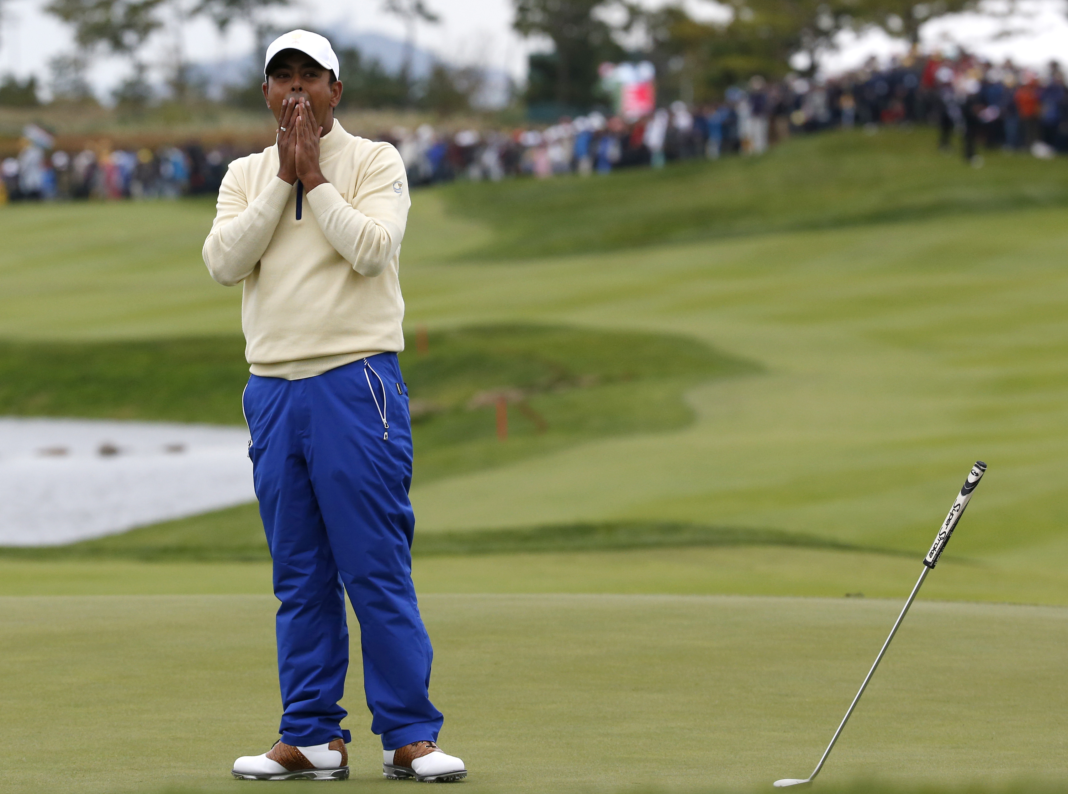 International team player Anirban Lahiri of India reacts on the 18th green after missing a putt to lose his match against United States' Chris Kirk in their singles match at the Presidents Cup golf tournament at the Jack Nicklaus Golf Club Korea, in Inche