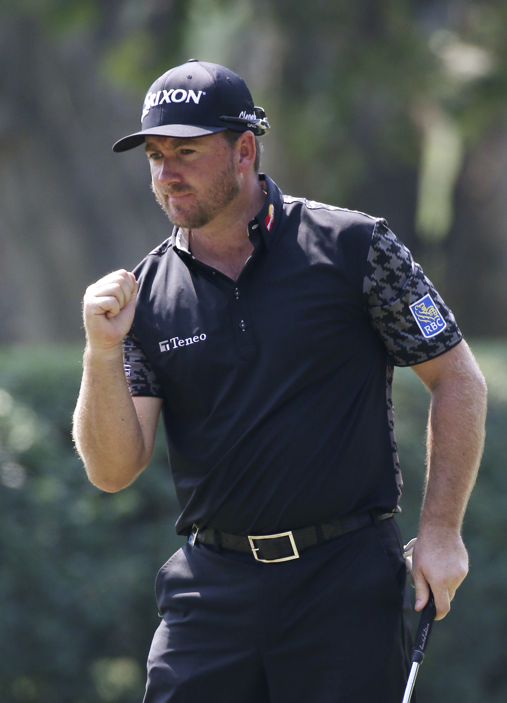 Graeme McDowell of Northern Ireland celebrates on the 10th hole during the round 2 match at the Hong Kong Open golf tournament, Friday, Oct. 23, 2015. (AP Photo/Kin Cheung)