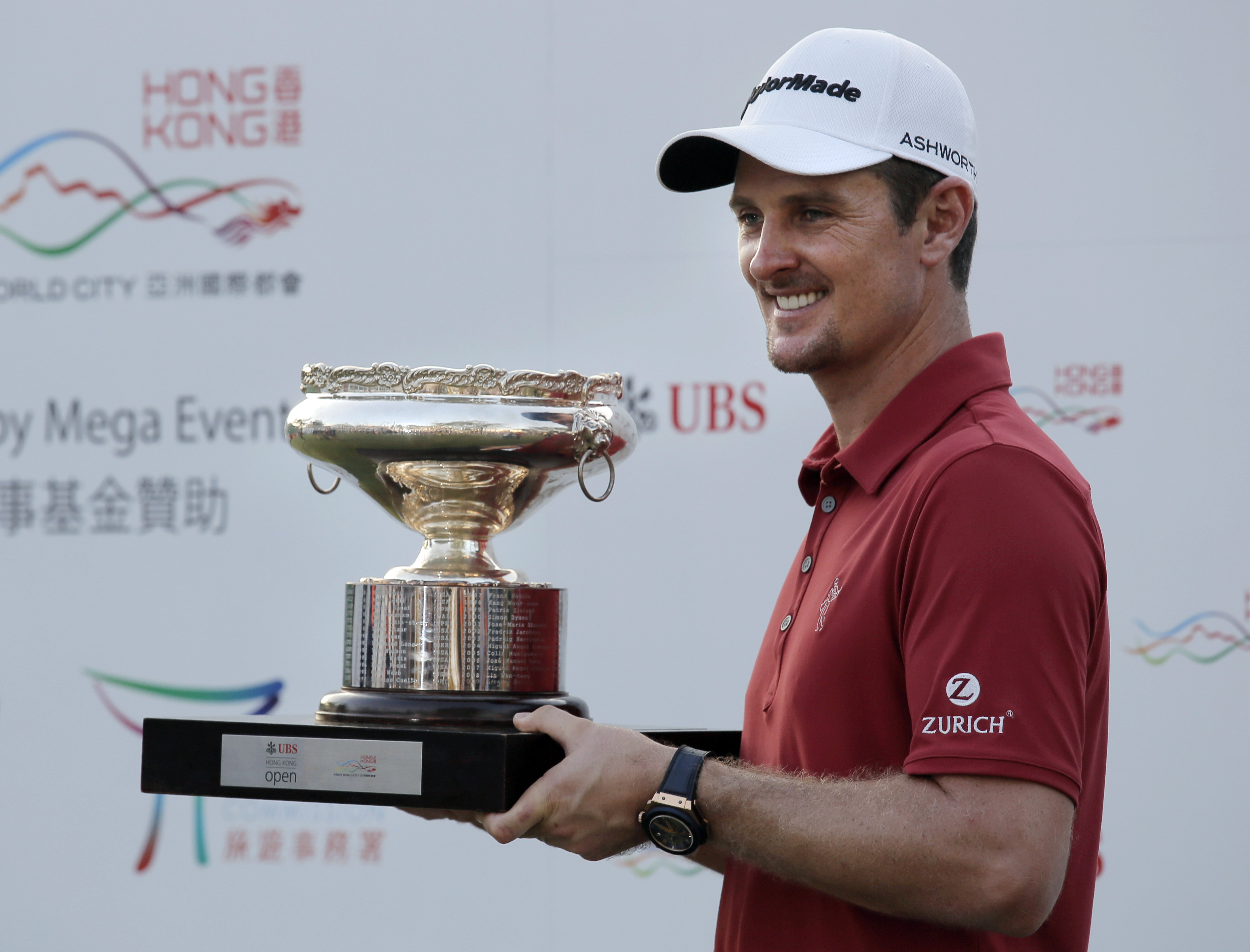 Justin Rose of England poses with the trophy after winning the final round of the Hong Kong Open golf tournament in Hong Kong, Sunday, Oct. 25, 2015. (AP Photo/Vincent Yu)