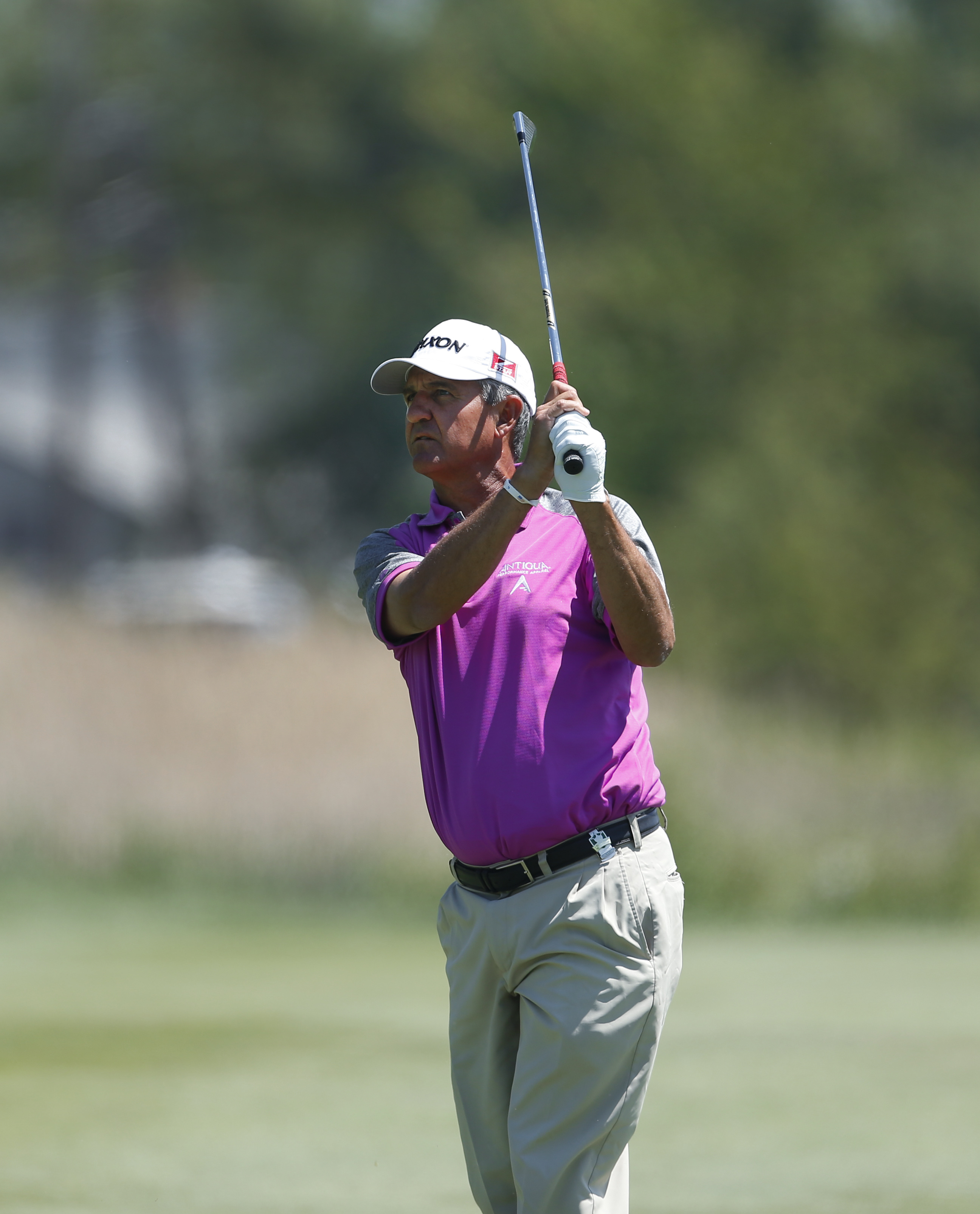 Steve Pate watches his fairway shot on the first hole during the final round of the 75th Senior PGA Championship golf tournament at Harbor Shores Golf Club in Benton Harbor, Mich., Sunday, May 25, 2014. (AP Photo/Paul Sancya)
