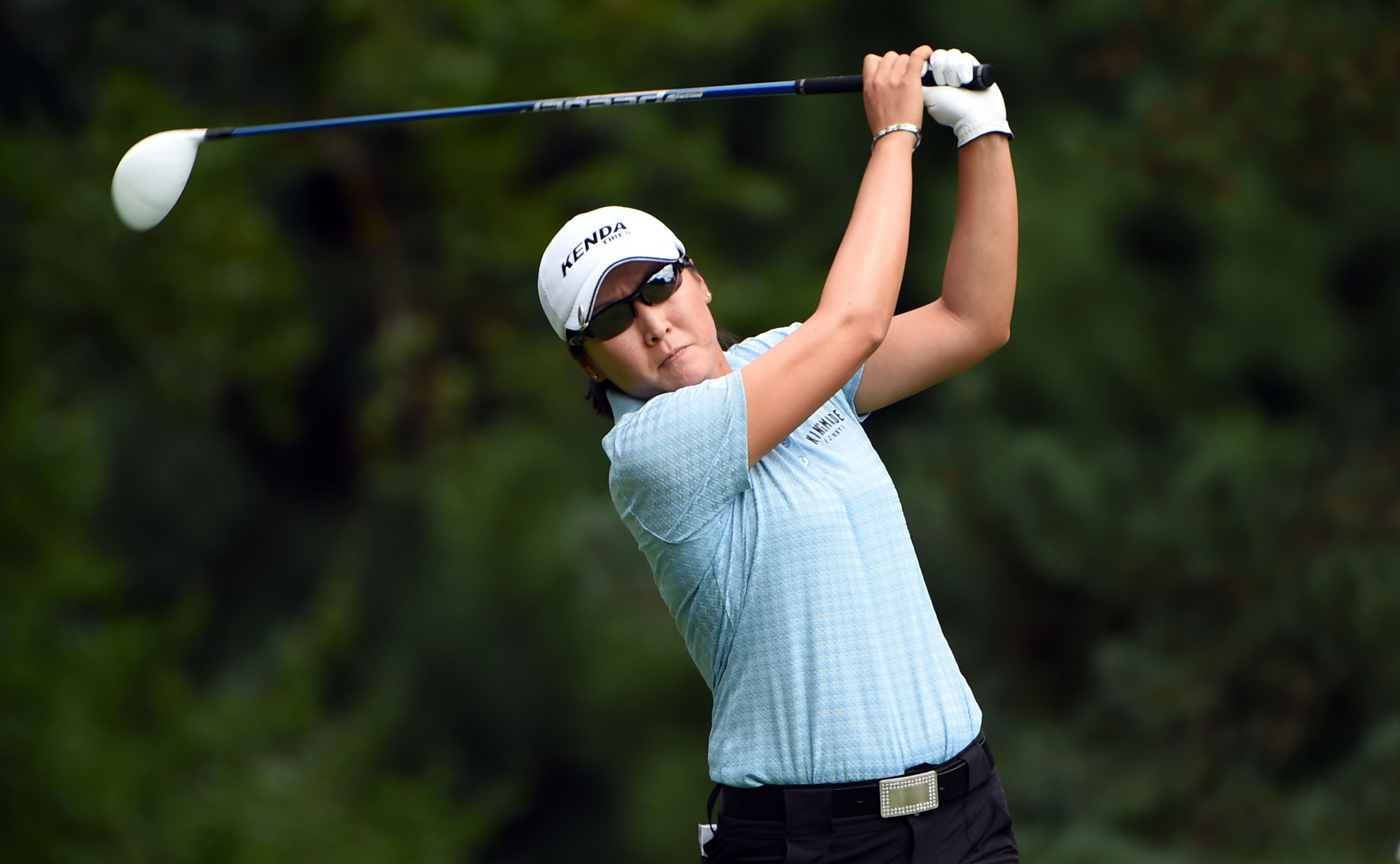 Candie Kung of Taiwan hits her tee shot on the third hole during the third round of the LPGA Cambia Portland golf tournament in Portland, Ore., Saturday, Aug. 15, 2015. (AP Photo/Steve Dykes)