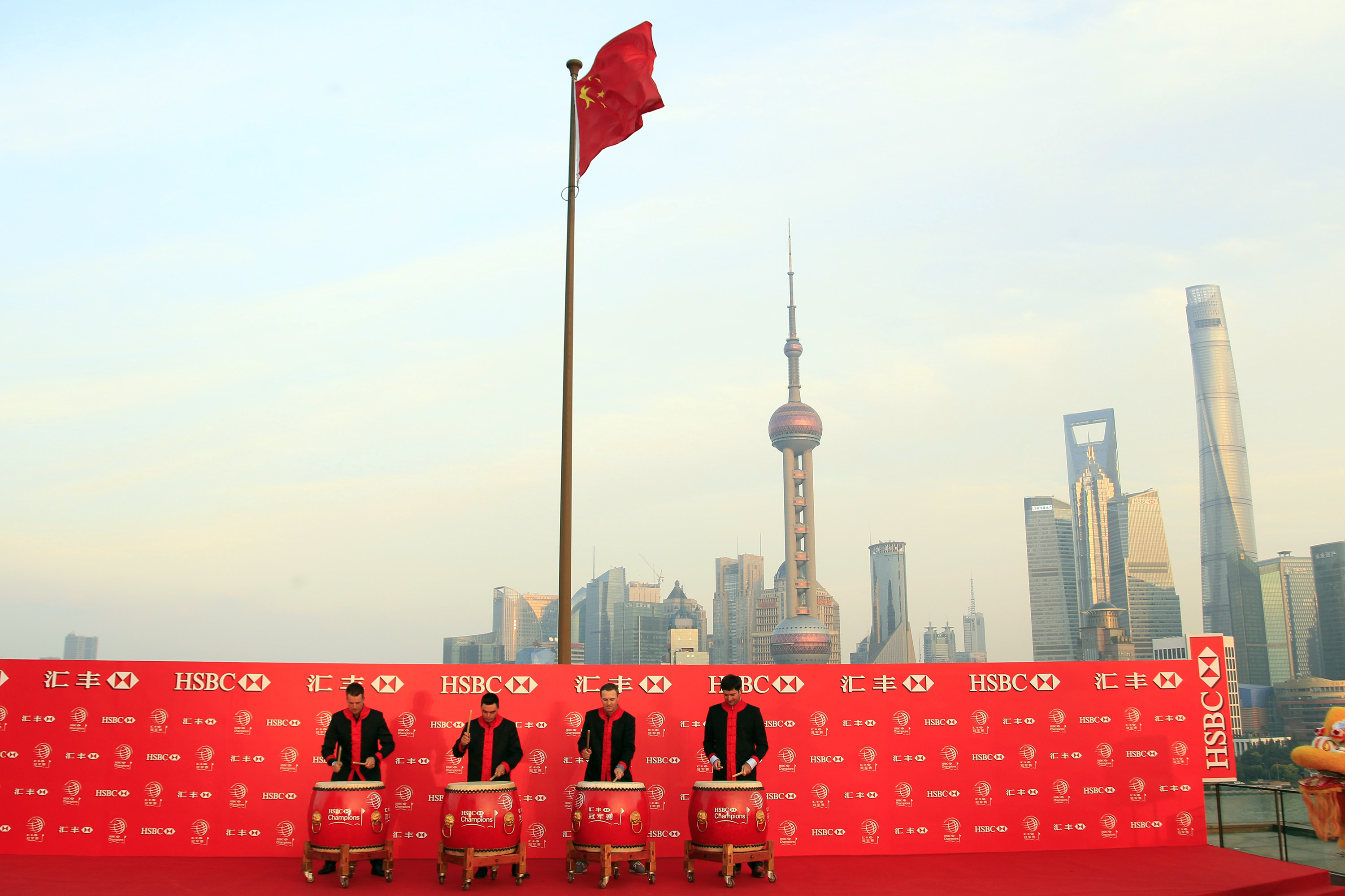 Golf players from left to right,  Henrik Stenson, Rickie Fowler, Jordan Spieth and Bubba Watson, drum during the HSBC Champions golf tournament photocall in Shanghai, China Thursday Nov. 3, 2015. (AP Photo)