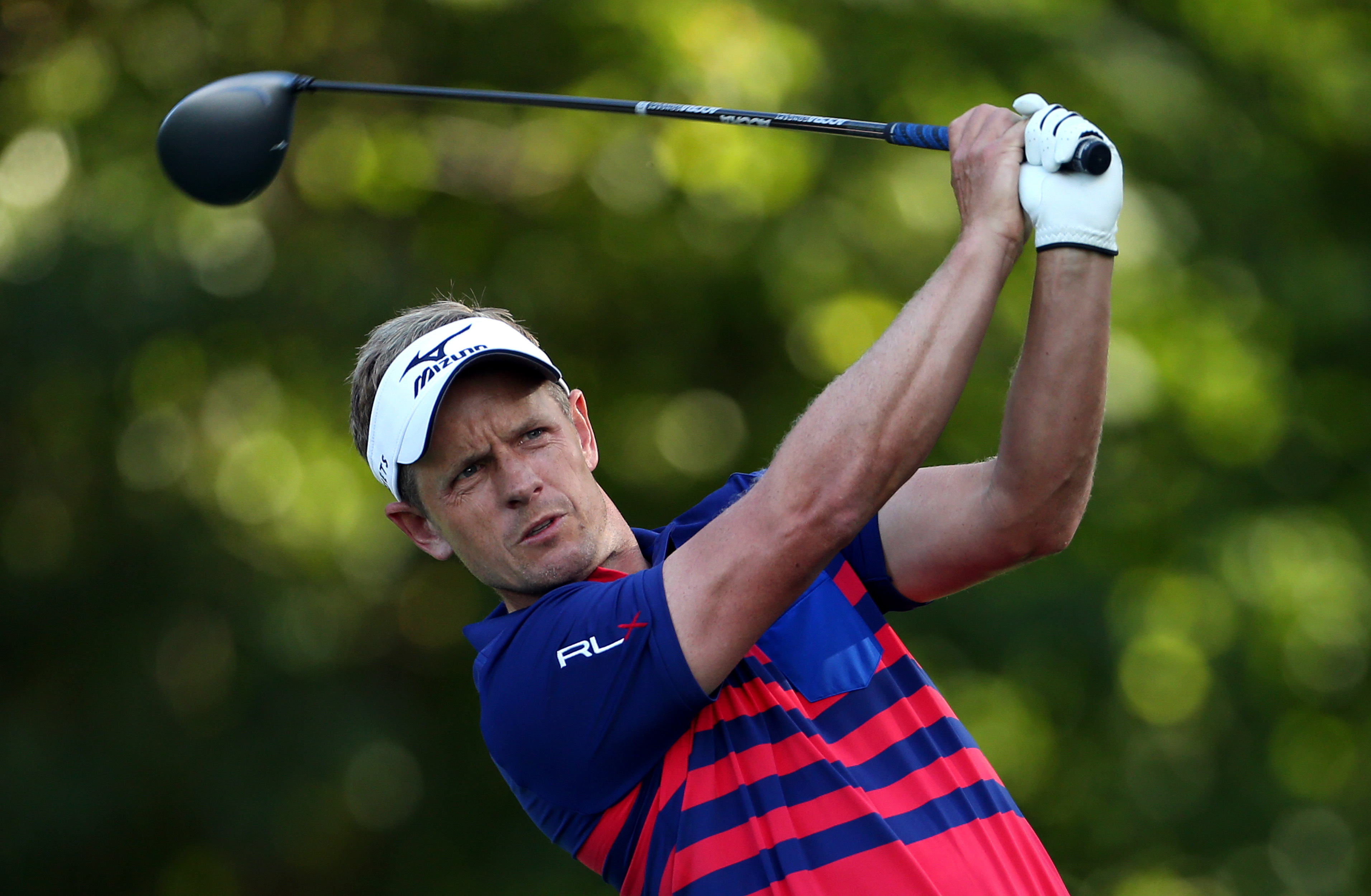 Luke Donald, of England, tees off on the fifth hole during the first round of play at The Barclays golf tournament Thursday, Aug. 27, 2015, in Edison, N.J. (AP Photo/Adam Hunger)