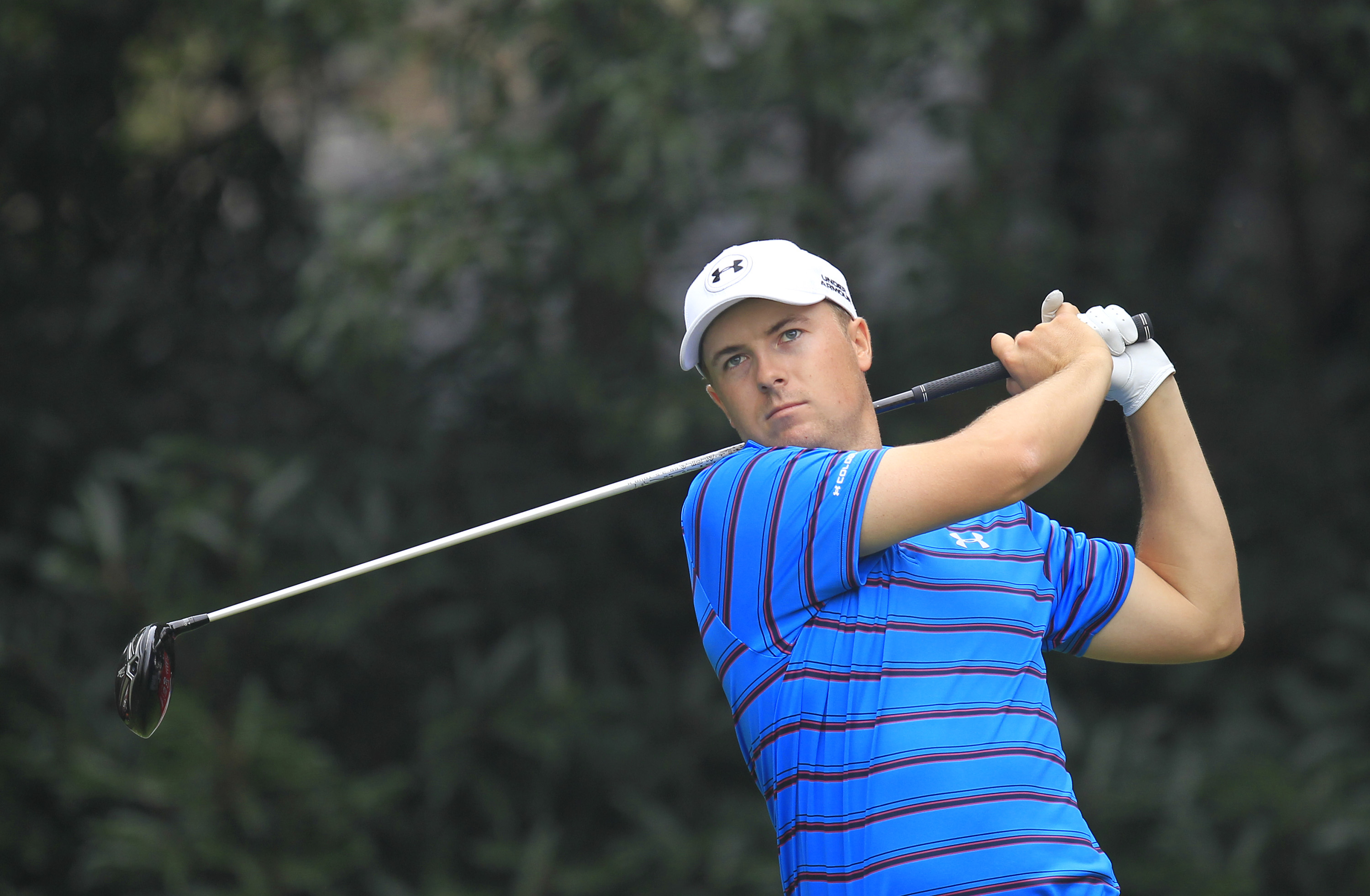 Jordan Spieth of the United States tees off on the 5th hole during the first round of the HSBC Champions golf tournament at the Sheshan International Golf Club in Shanghai, China Thursday, Nov. 5, 2015. (AP Photo)