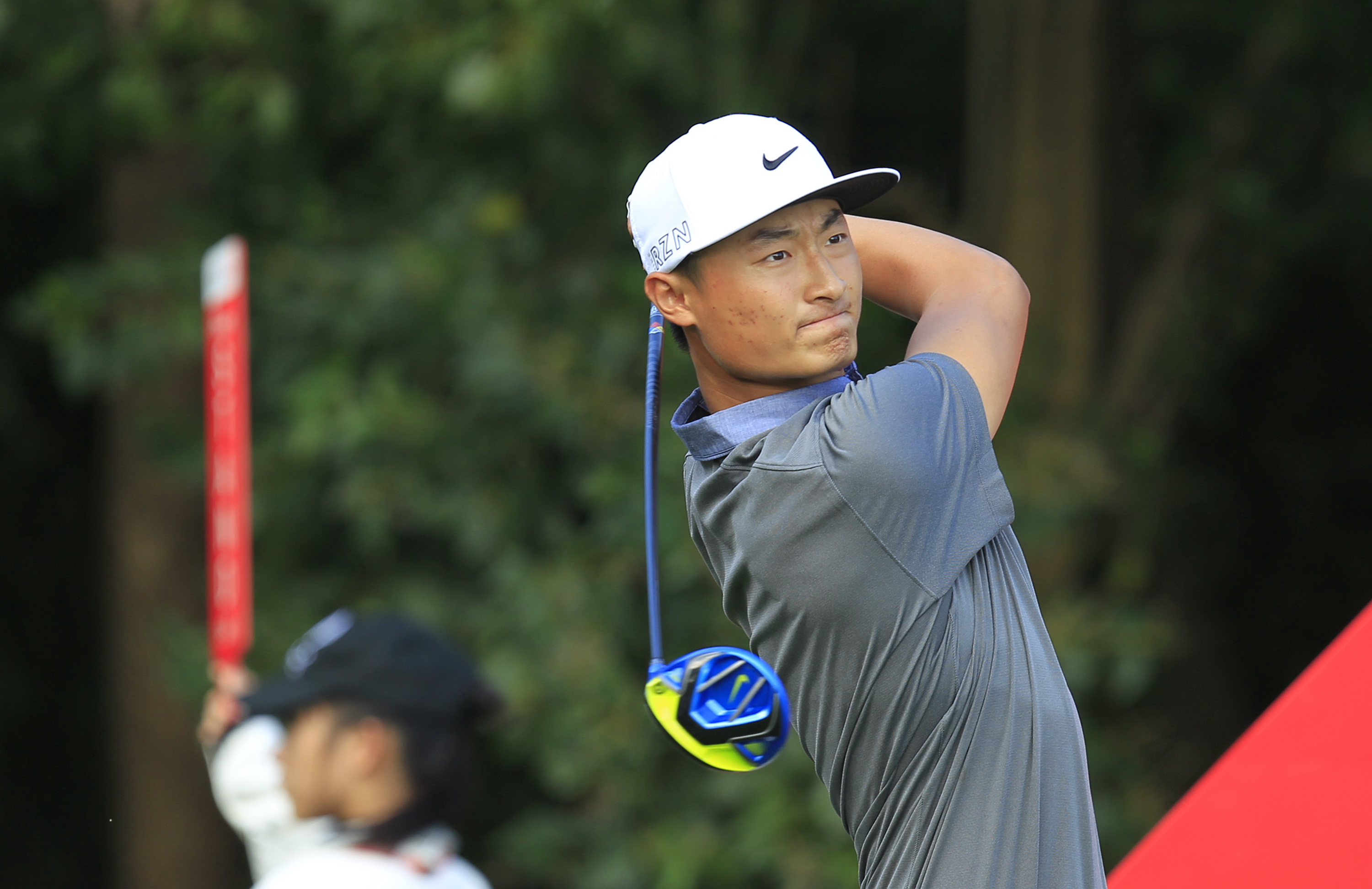 Li Haotong of China tees off on the 9th hole during the second round of the HSBC Champions golf tournament at the Sheshan International Golf Club in Shanghai, China Friday, Nov. 6, 2015. (AP Photo)