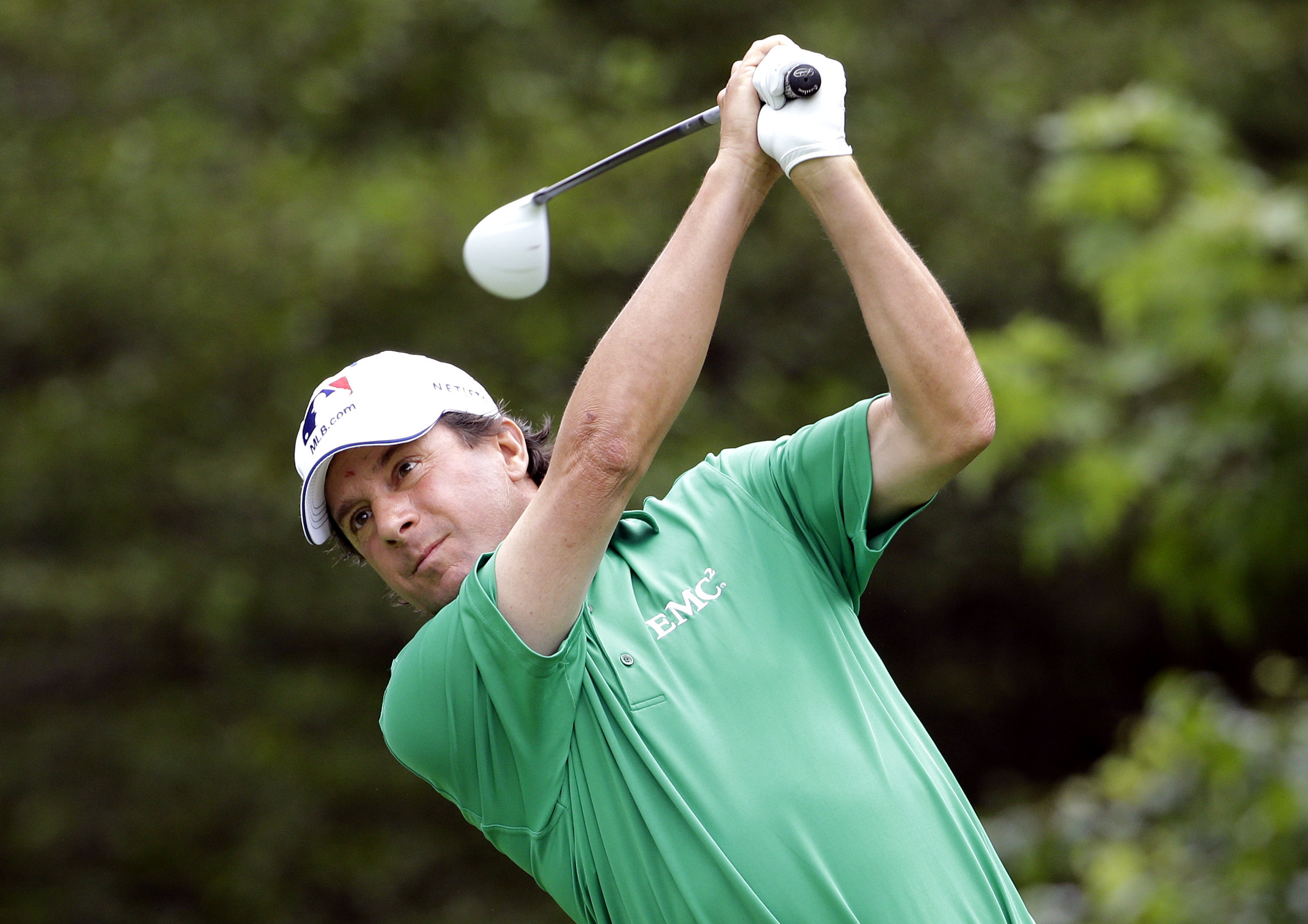 Billy Andrade follows through on a tee shot on the 17th during the pro-am for the Champions Tour's Encompass Championship golf tournament Thursday, July 9, 2015, in Glenview, Ill. (AP Photo/Nam Y. Huh)