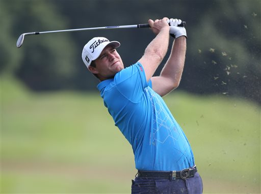 Lucas Bjerregaard of Denmark hits a shot from fairway on the 14th hole during round 3 of the Hong Kong Open golf tournament in Hong Kong, Saturday, Oct. 24, 2015. (AP Photo/Kin Cheung)