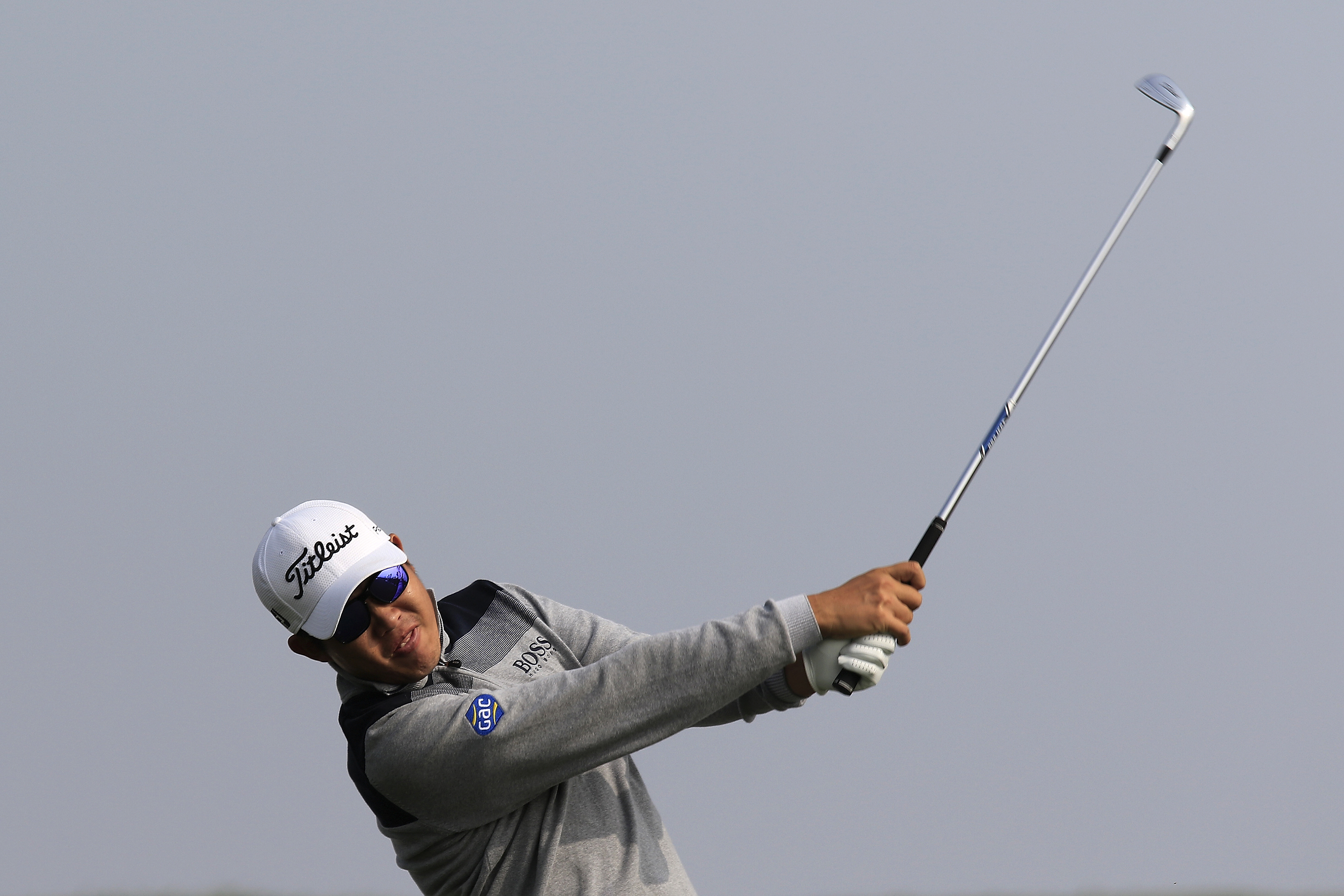 Byeong-Hun An of South Korea tees off on the 6th hole during the third round of the BMW Masters golf tournament at the Lake Malaren Golf Club in Shanghai, China, Saturday, Nov. 14, 2015. (AP Photo)