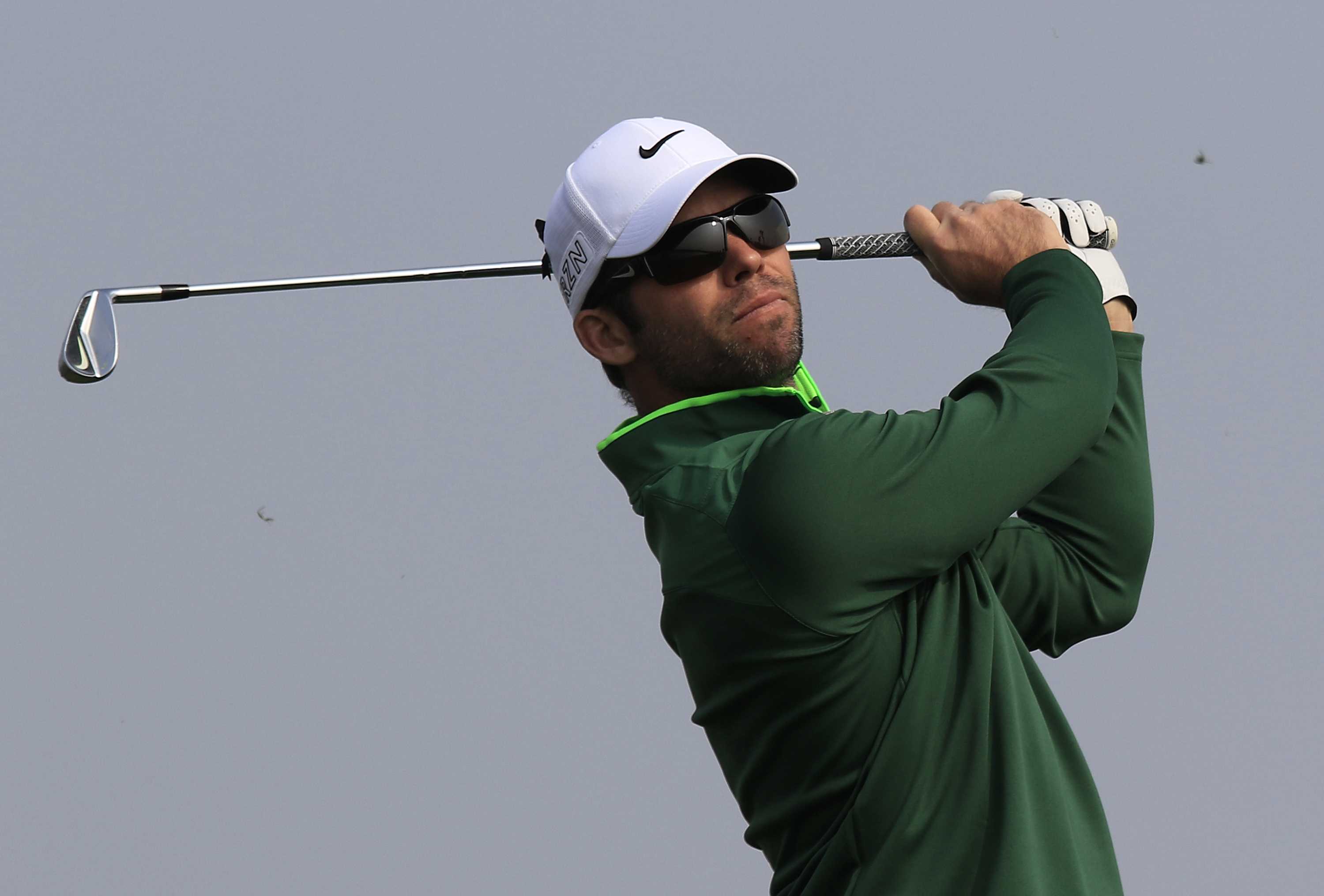 Paul Casey of England watches his tees on the 6th hole during the third round of the BMW Masters golf tournament at the Lake Malaren Golf Club in Shanghai, China, Saturday, Nov. 14, 2015. (AP Photo)