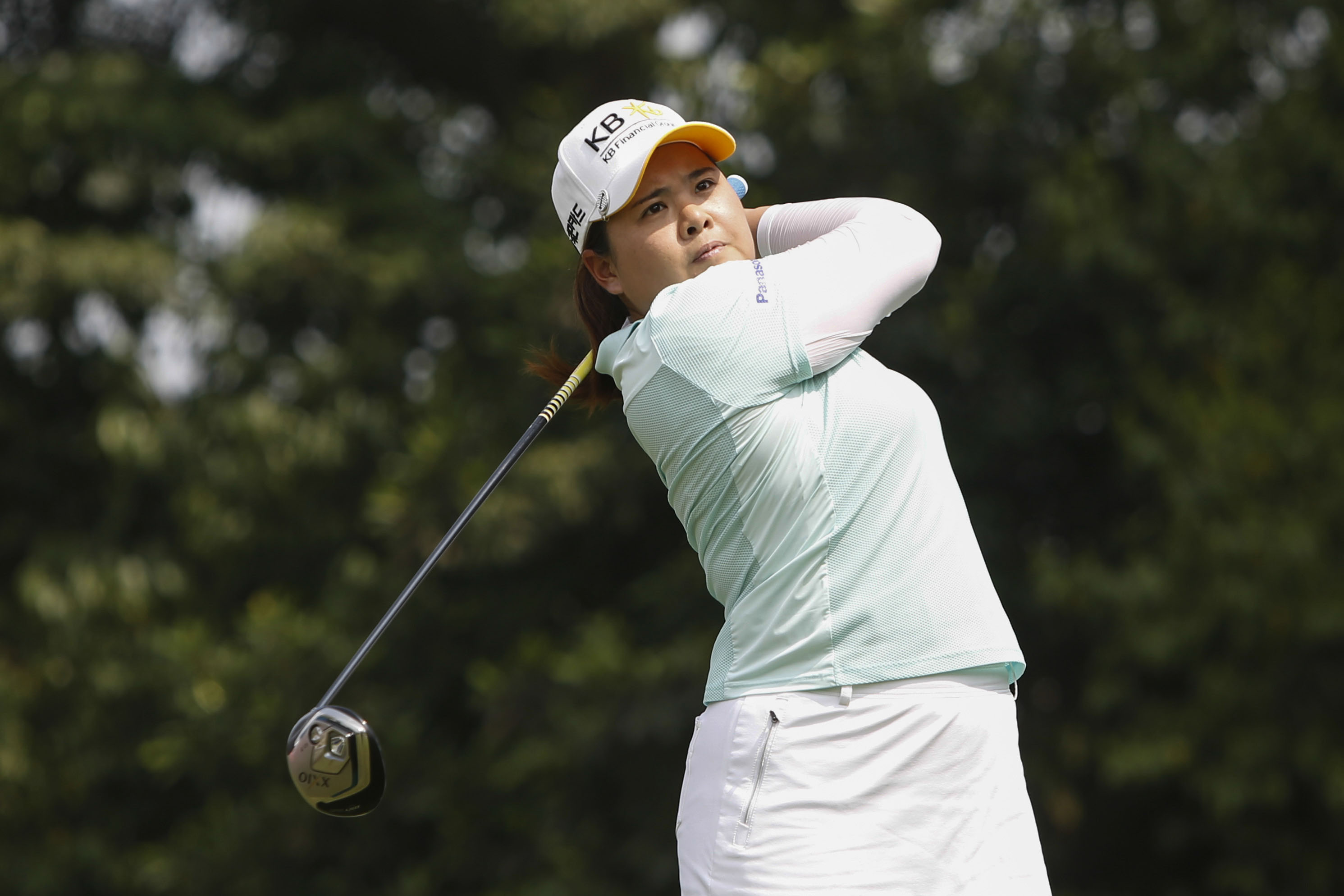 Inbee Park of South Korea tees off from the sixth hole during the first round of the LPGA Malaysia golf tournament at Kuala Lumpur Golf and Country Club in Kuala Lumpur, Malaysia on Thursday, Oct. 8, 2015. (AP Photo/Joshua Paul)