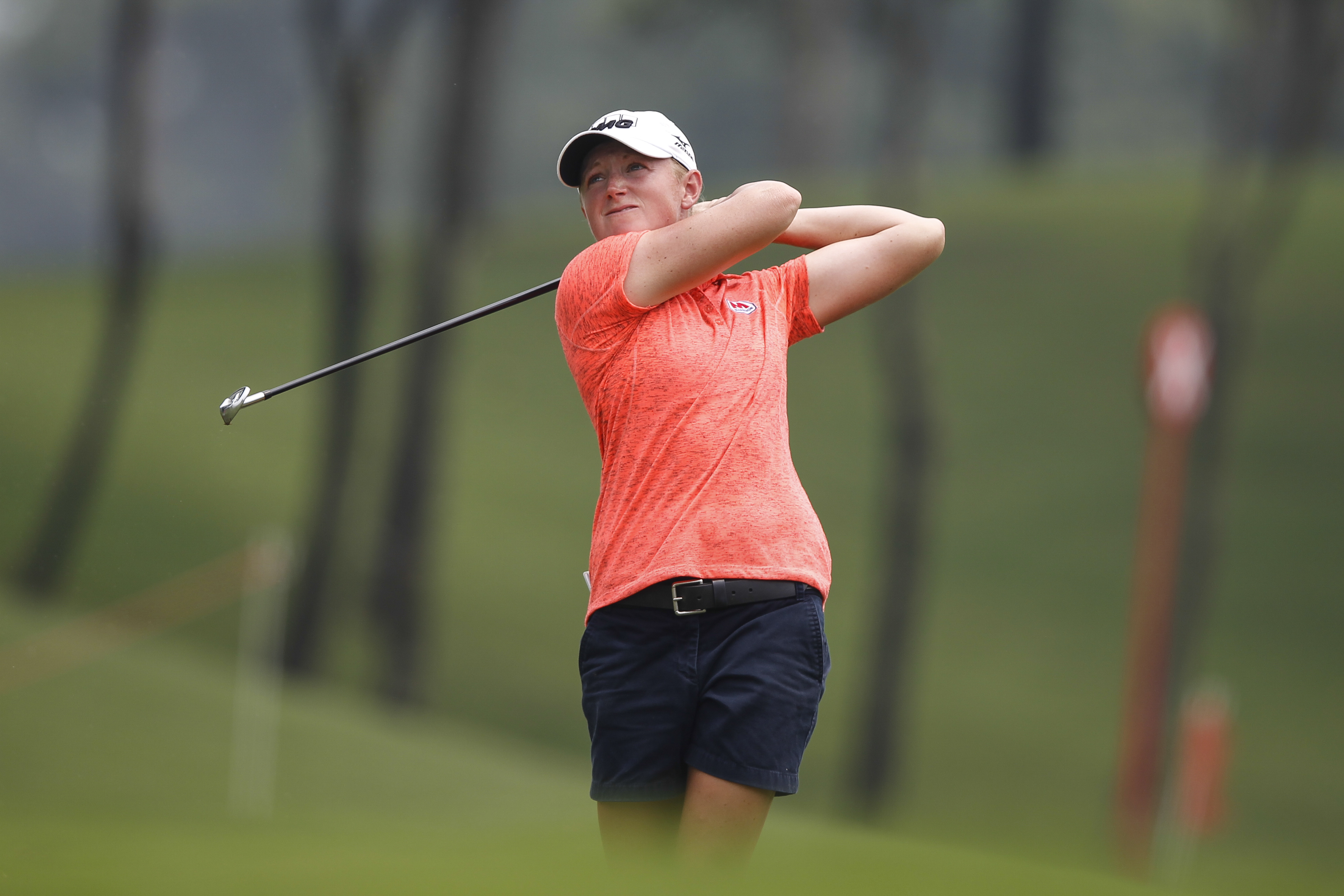 Stacy Lewis of the United States watches her approach shot onto the 18th green during the third round of the LPGA Malaysia golf tournament at Kuala Lumpur Golf and Country Club in Kuala Lumpur, Malaysia, Saturday, Oct. 10, 2015. (AP Photo/Joshua Paul)